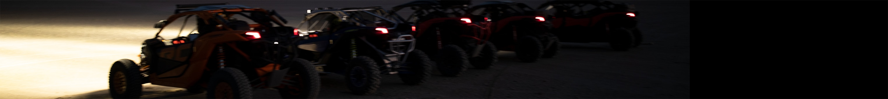Rear shots of Maverick SSV driving in the night