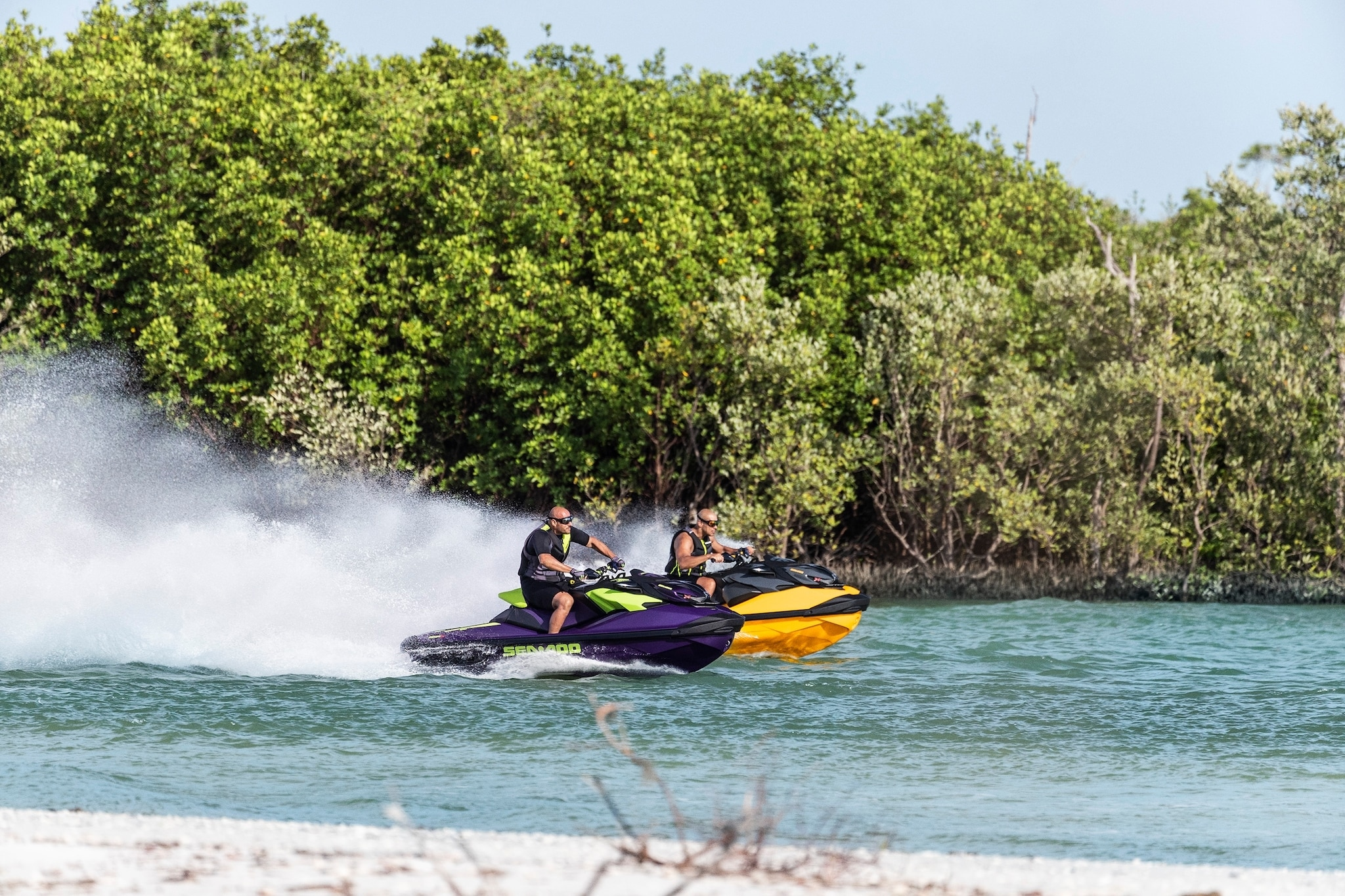 Man sipping a cup of tea on his Sea-doo personal watercraft