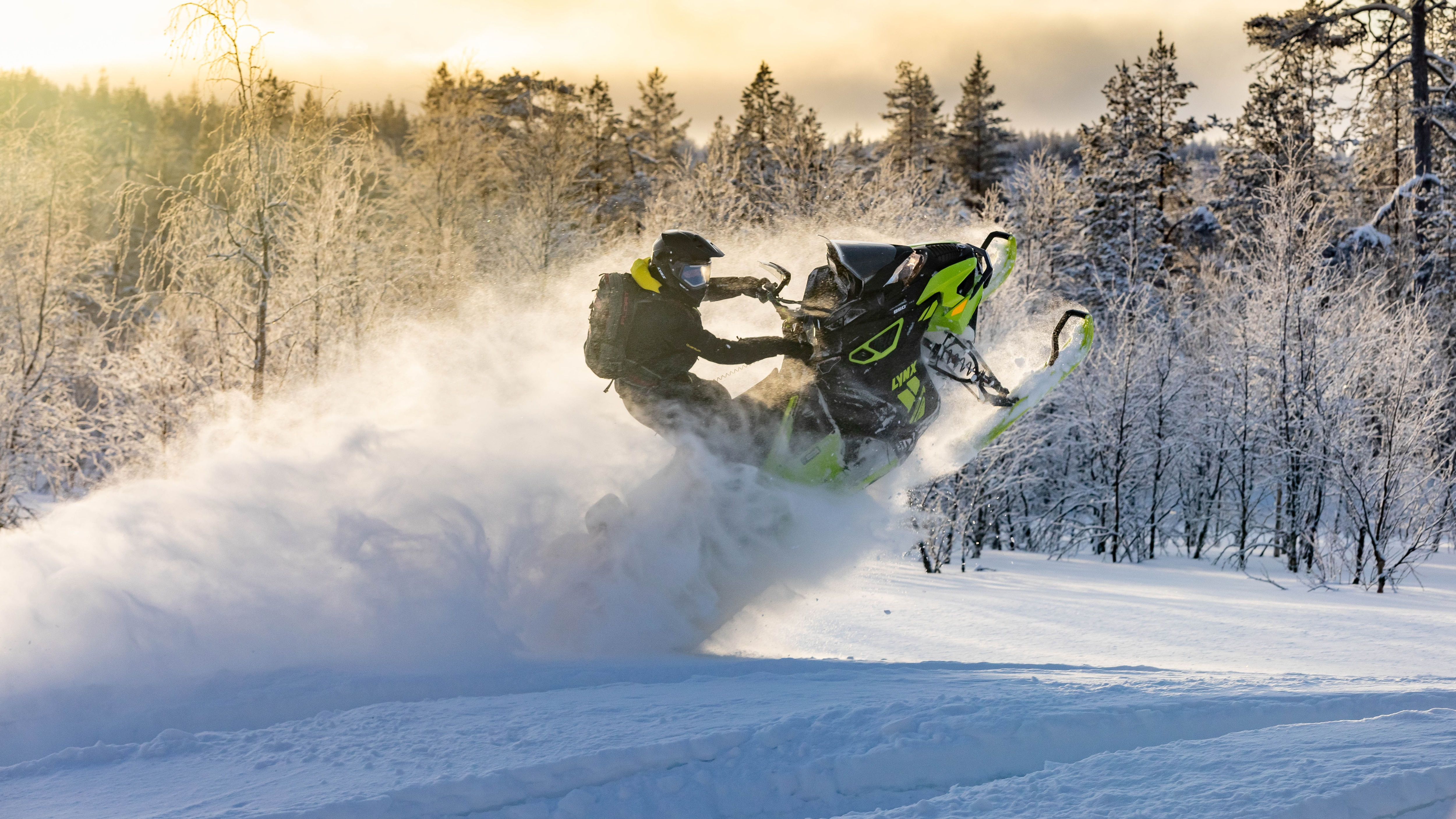 Man on a 2021 Lynx snowmobile