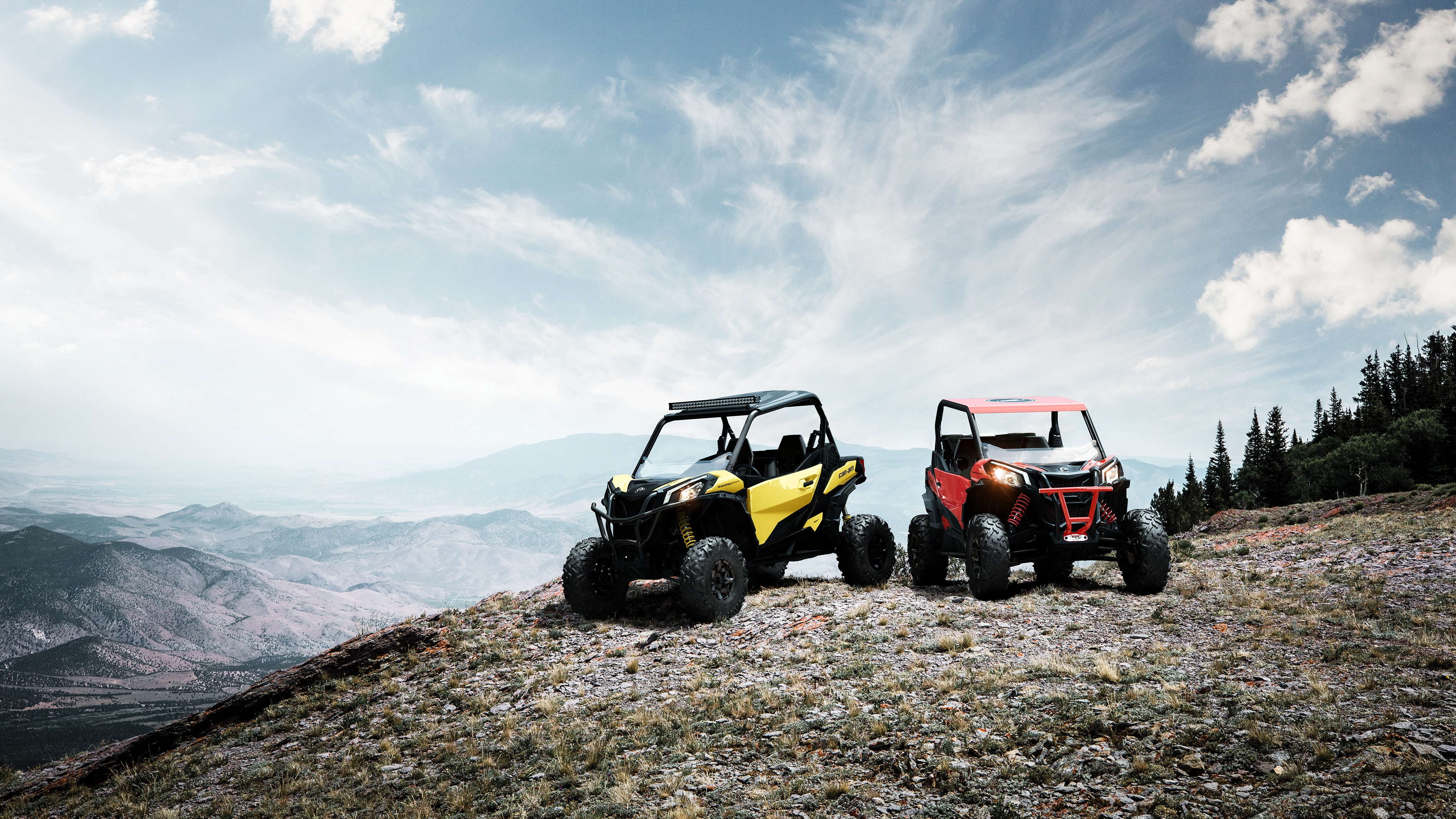 Pair of Can-Am Off-Road side-by-side vehicles on a mountain