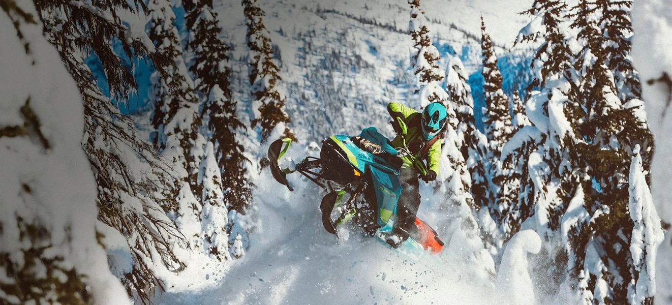 Man riding a Ski-Doo snowmobile