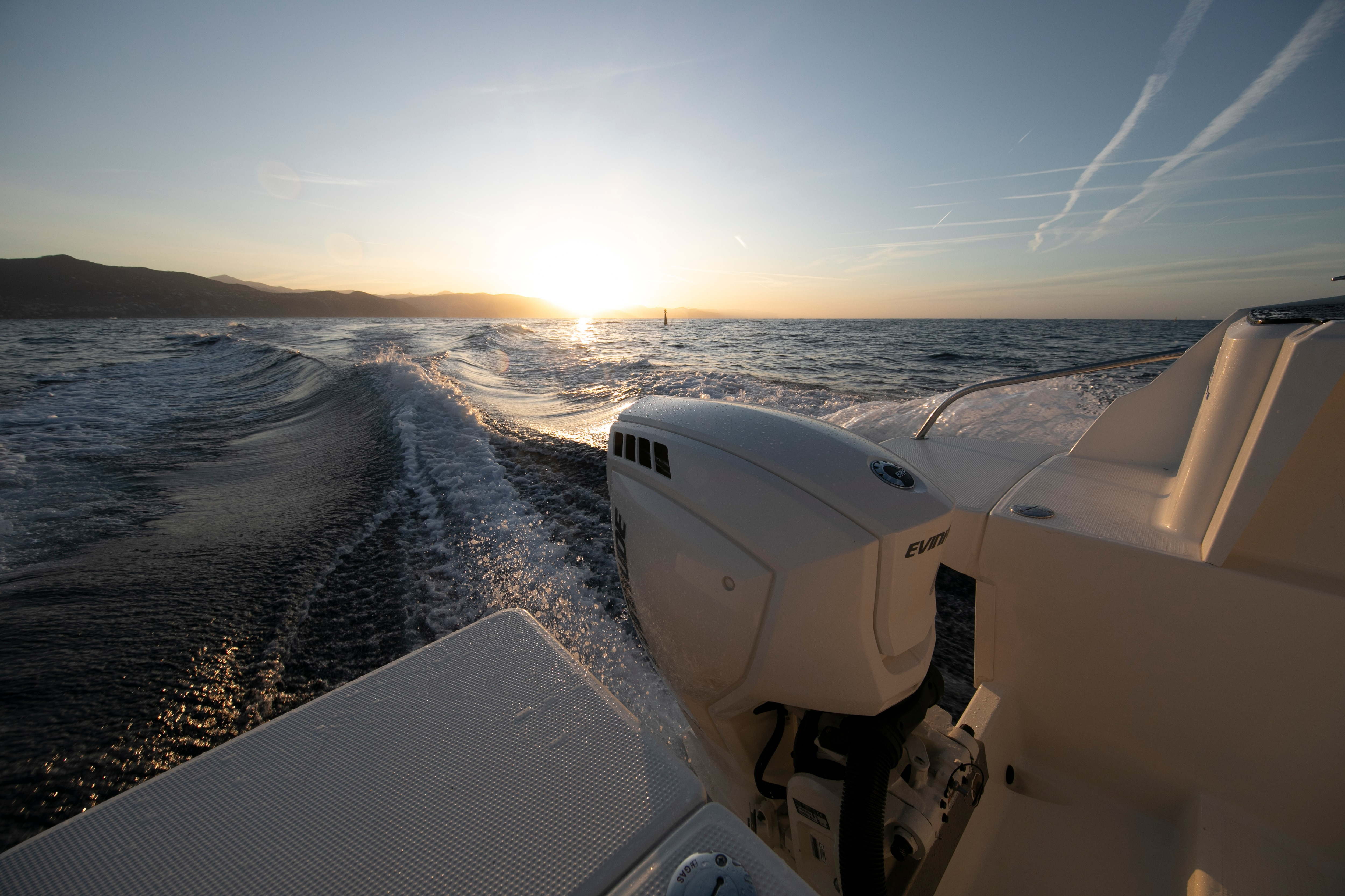 Evinrude motor with a sunset in the background