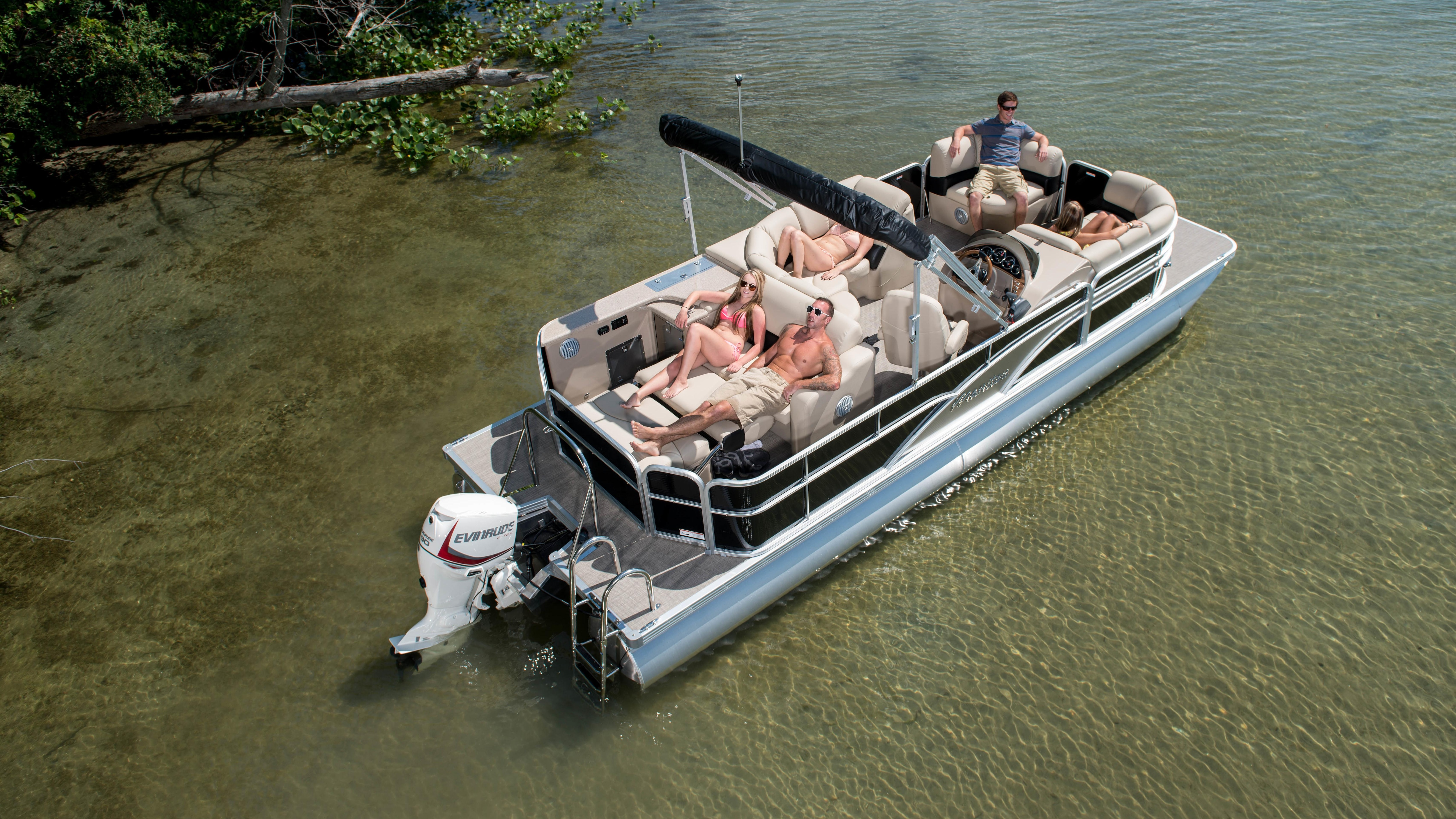 Group of friends relaxing on a pontoon