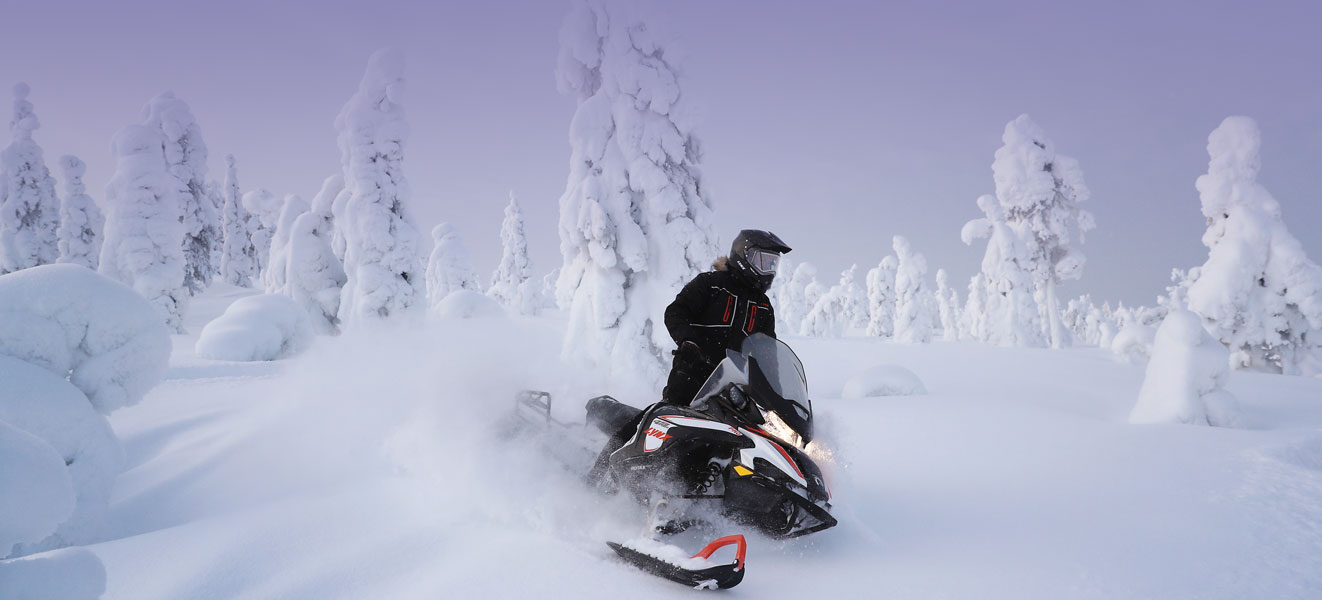 A man is turning left with his Lynx 49 Ranger Snowmobile Model