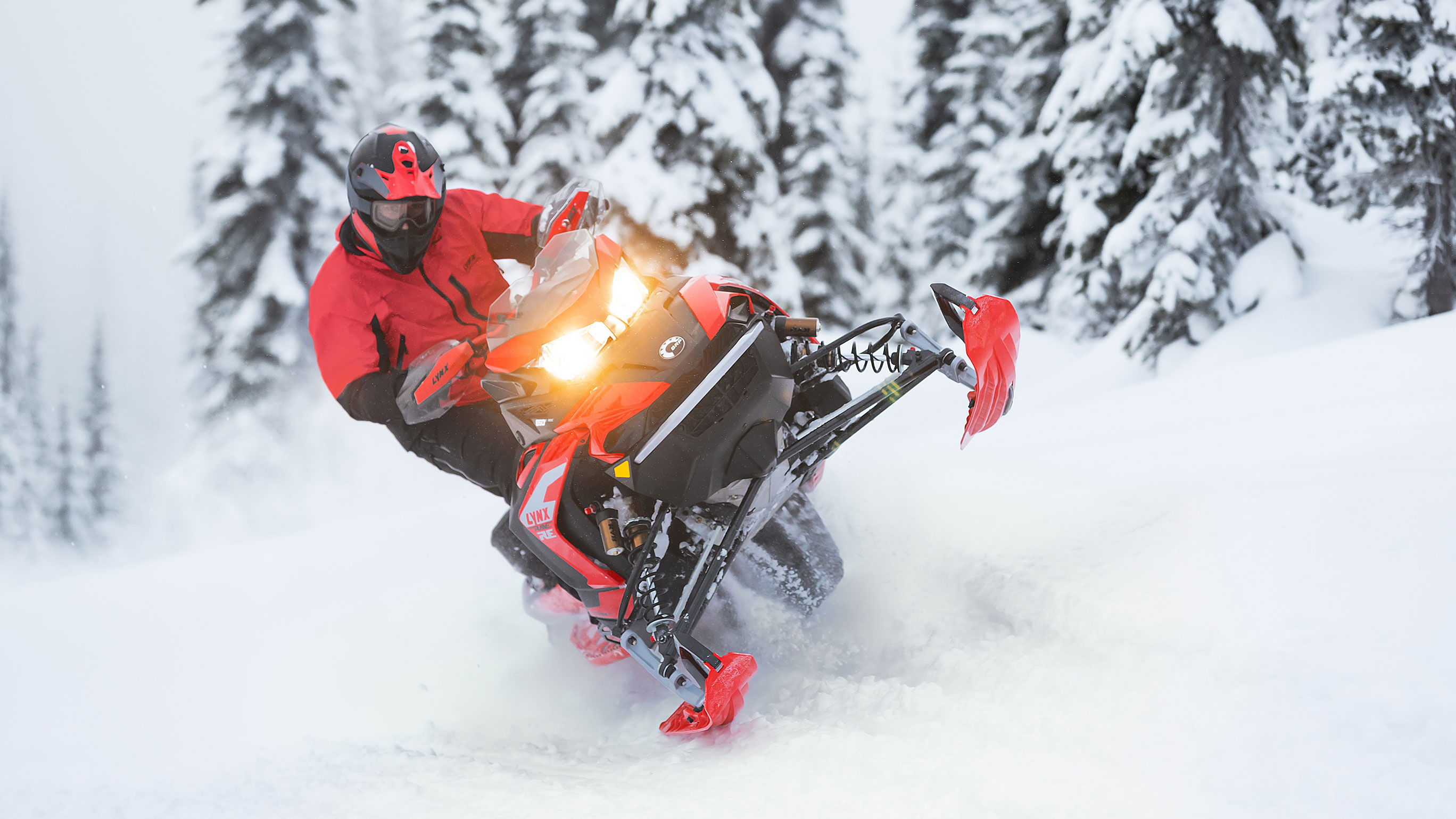 Lynx Rave snowmobiles sporty riding on bumpy trail