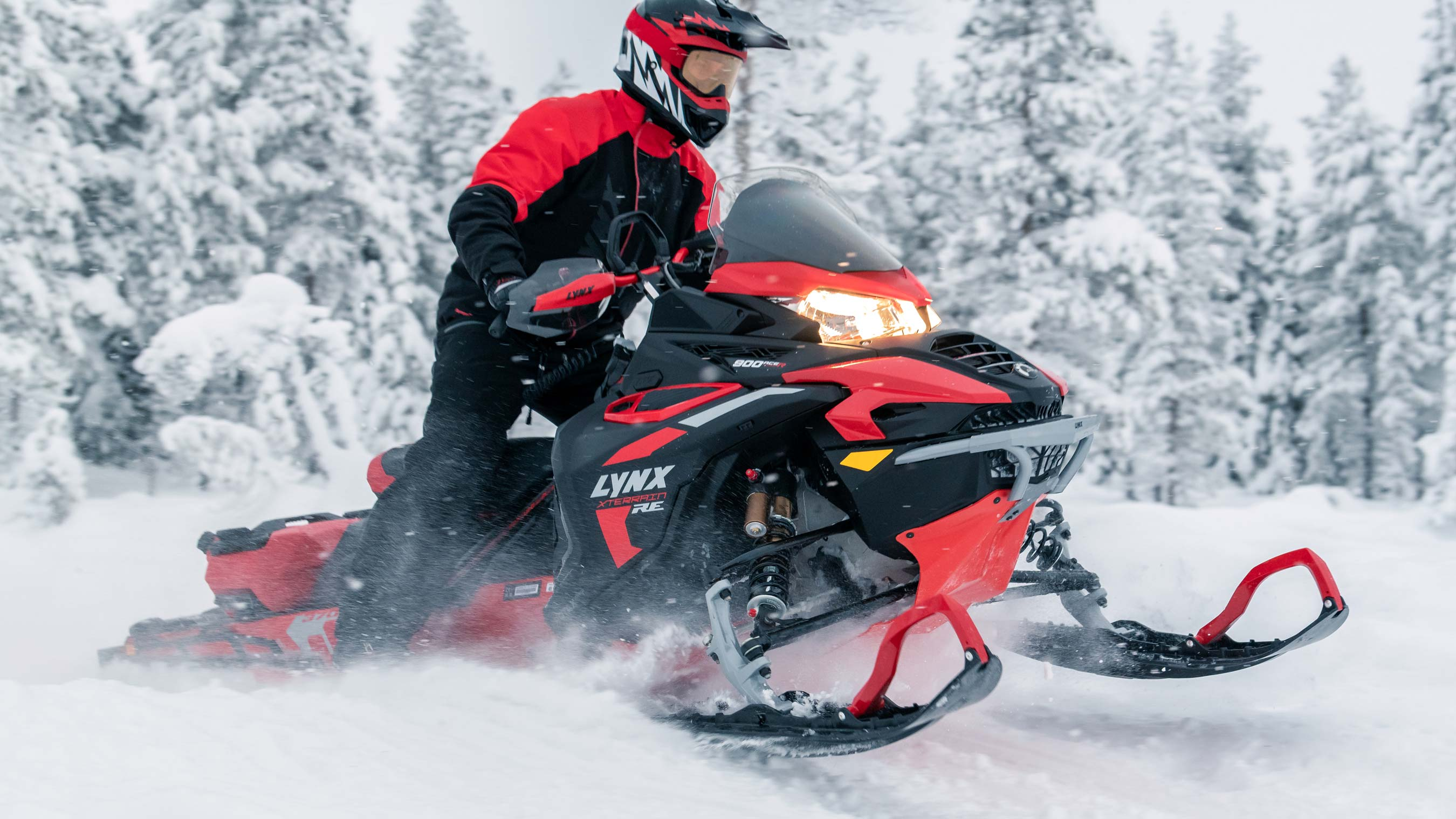 Lynx Xterrain RE snowmobile riding in snowy forest