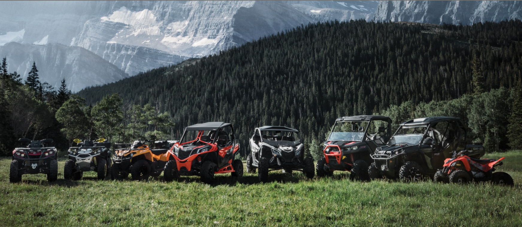 Can-Am Off-Road side-by-side and ATV lineup with a scenic background