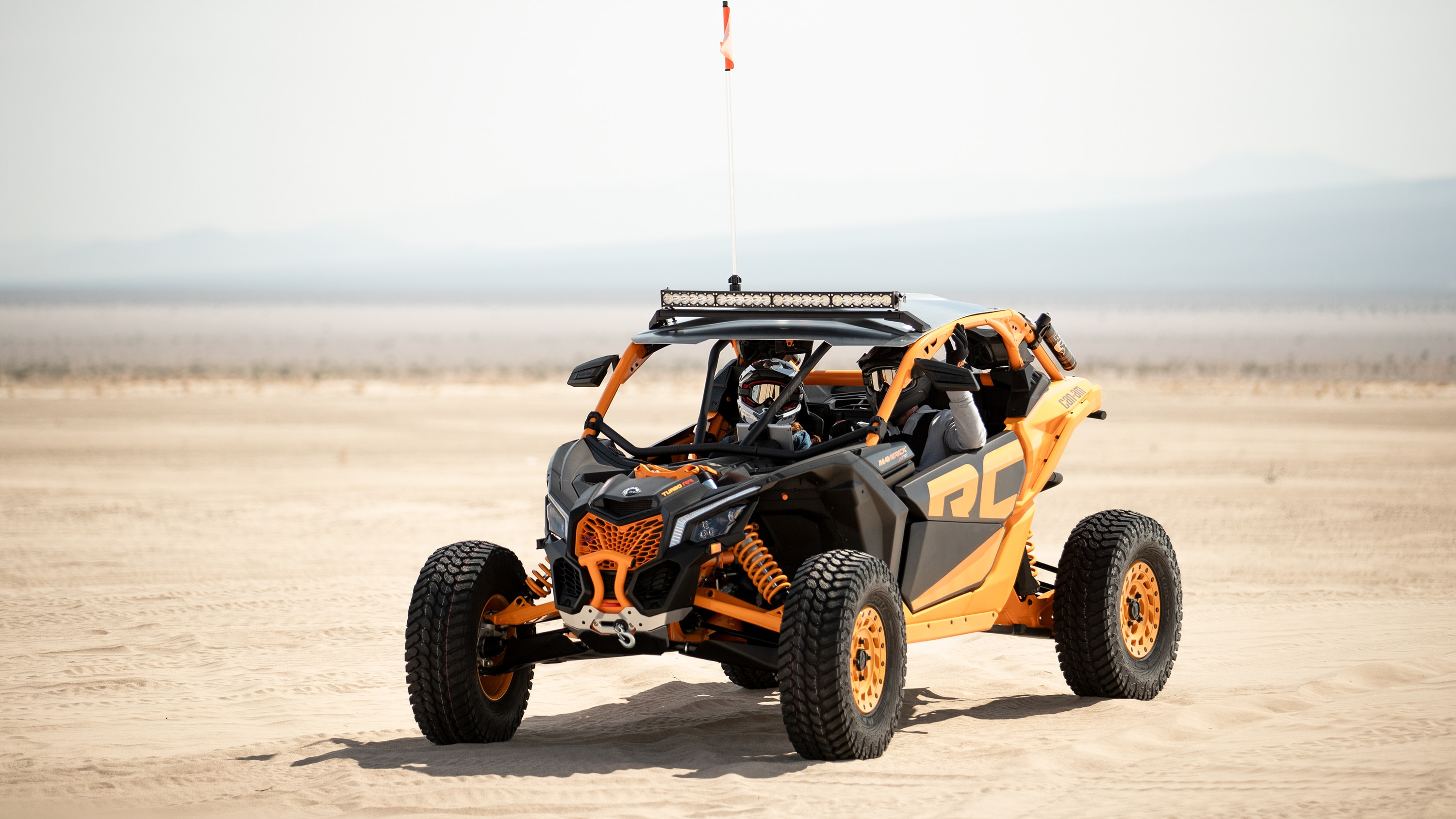 Two men in a Maverick X RC in the desert