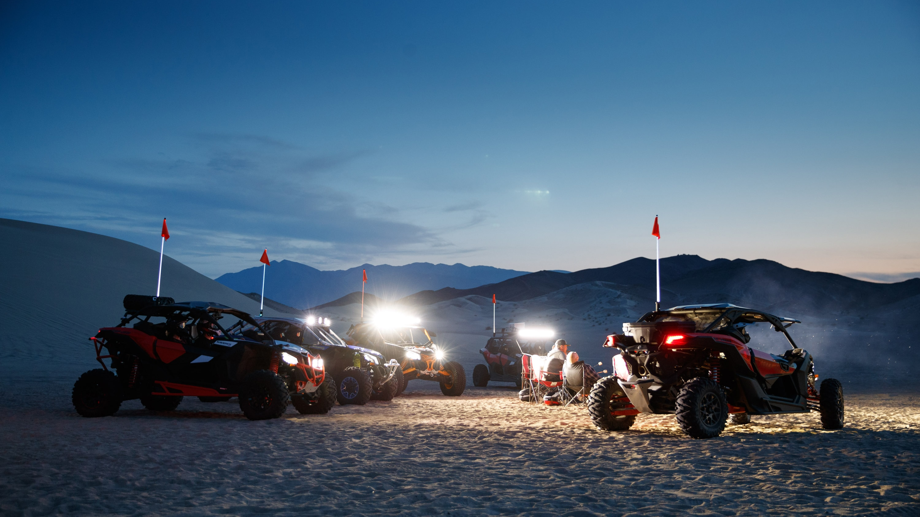 Five Maverick models at night in the desert