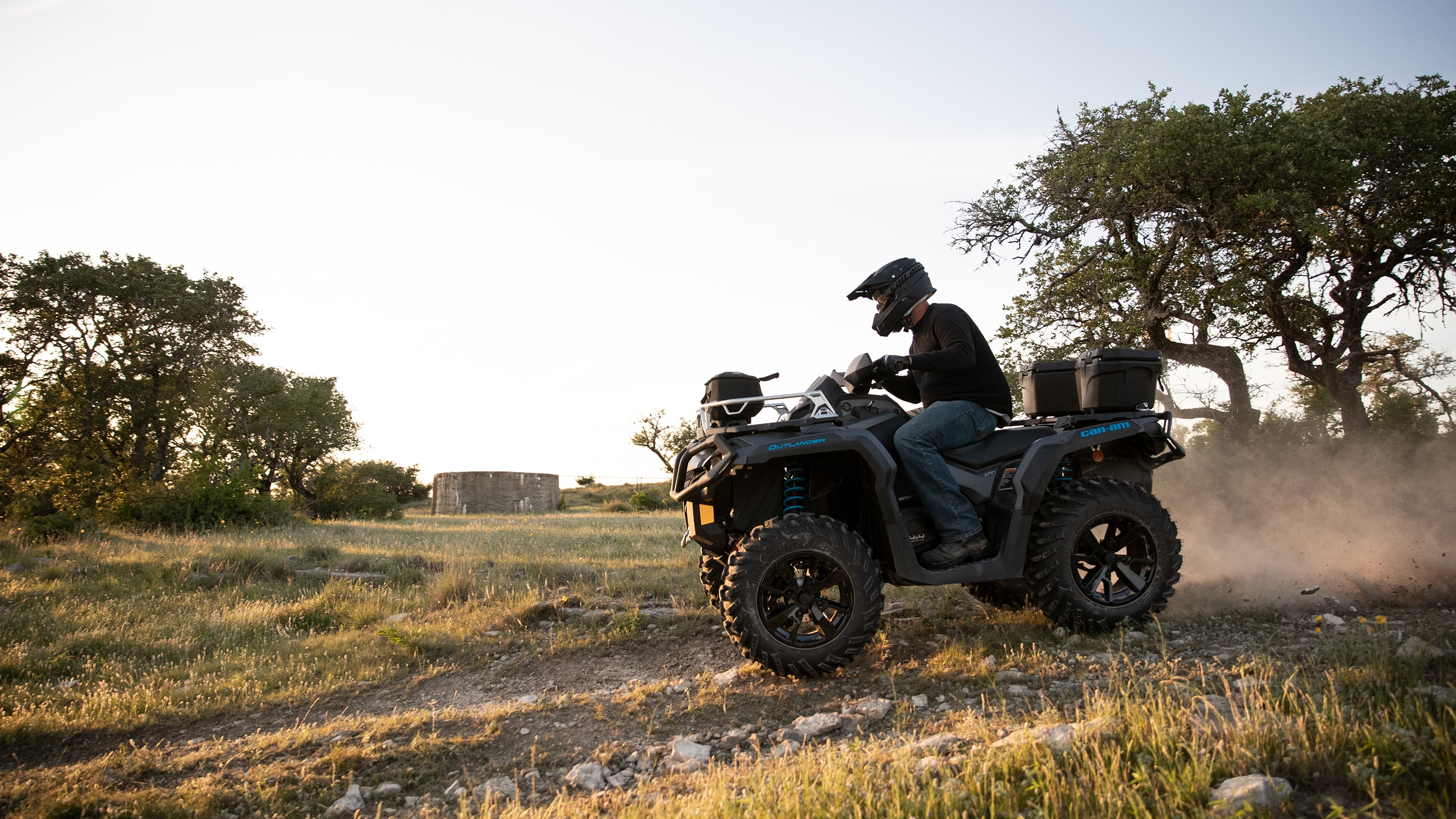 Man driving his Outlander ATV on an open field
