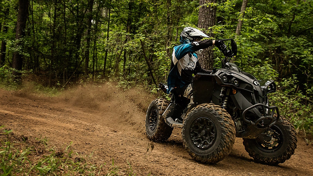 Man drifting on a muddy trail with his Can-Am Renegade