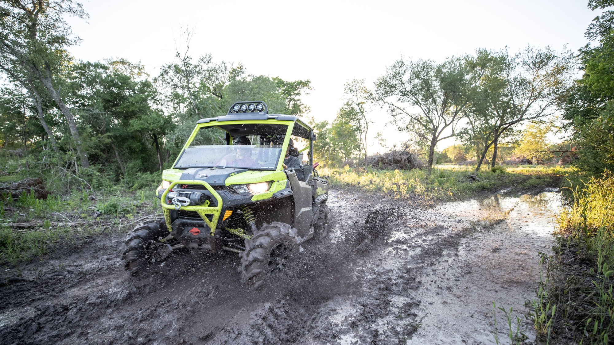Men driving Traxter through mud