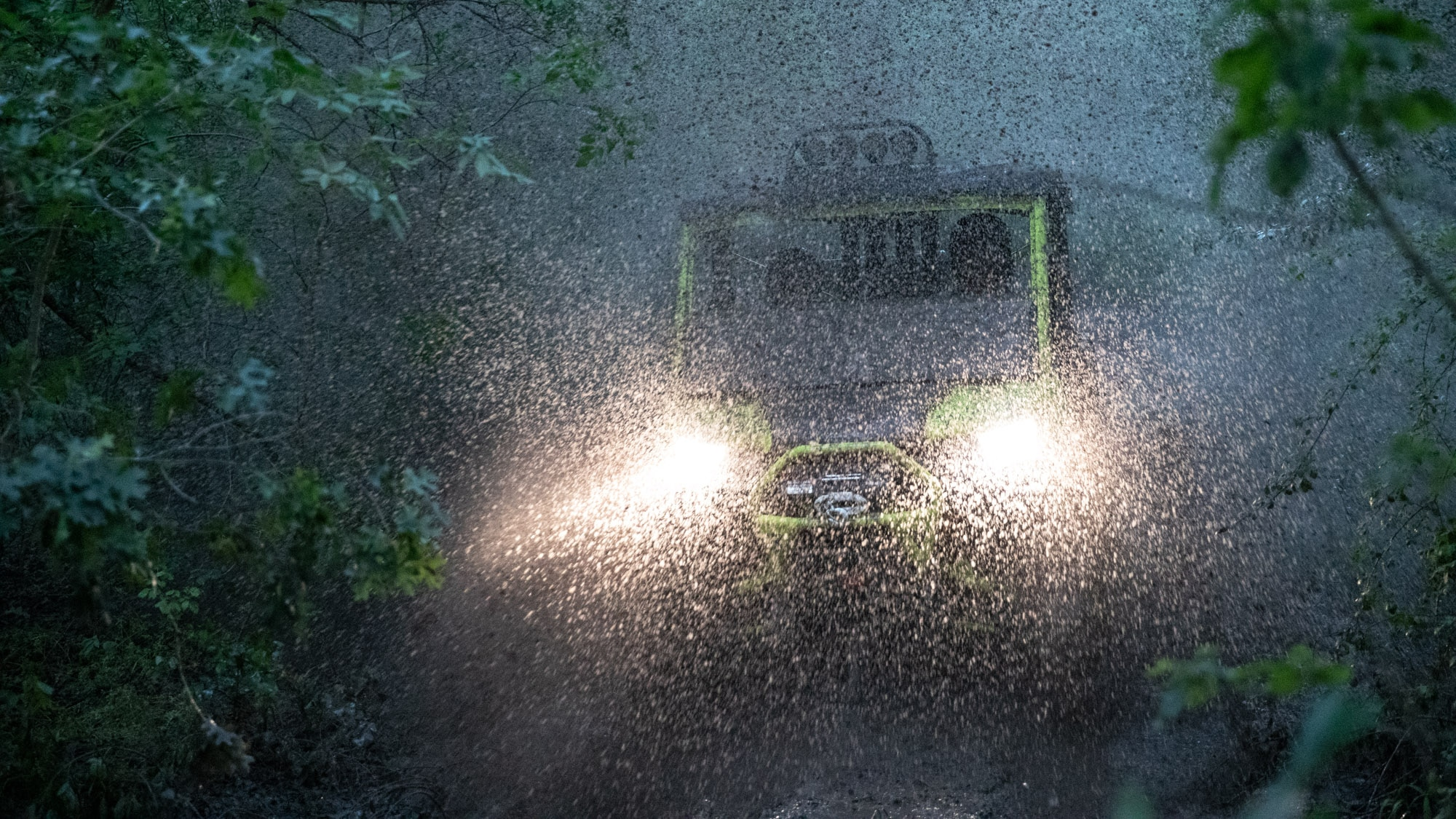 Men driving Traxter through heavy rain