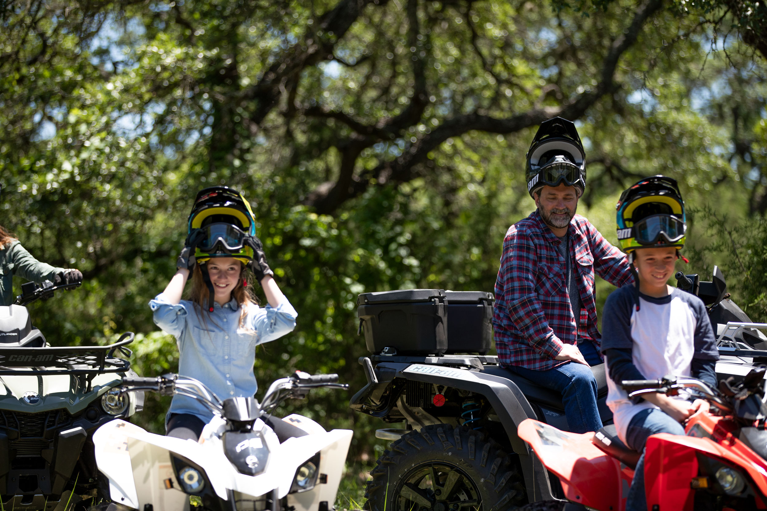 Family near their DS and Outlander ATV in the woodland