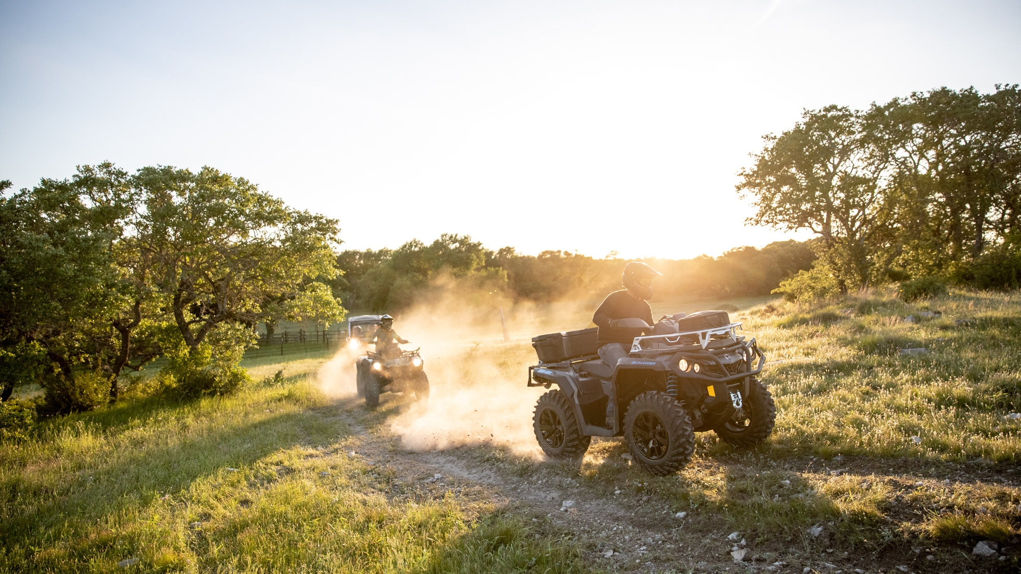 Pair of Can-Am Outlander 2021 driving in a scenic trail