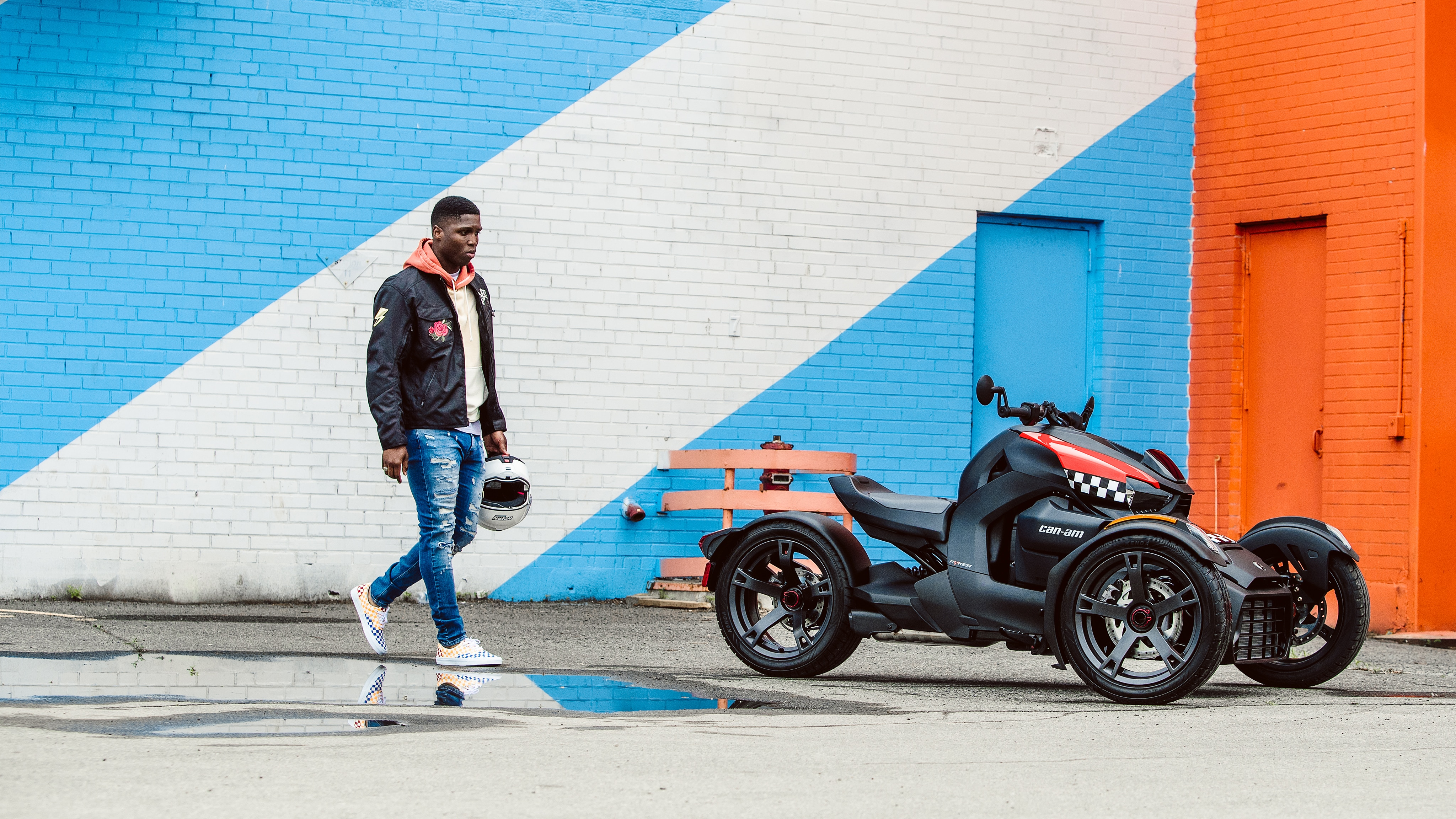 Man walking toward his Can-Am Ryker vehicle