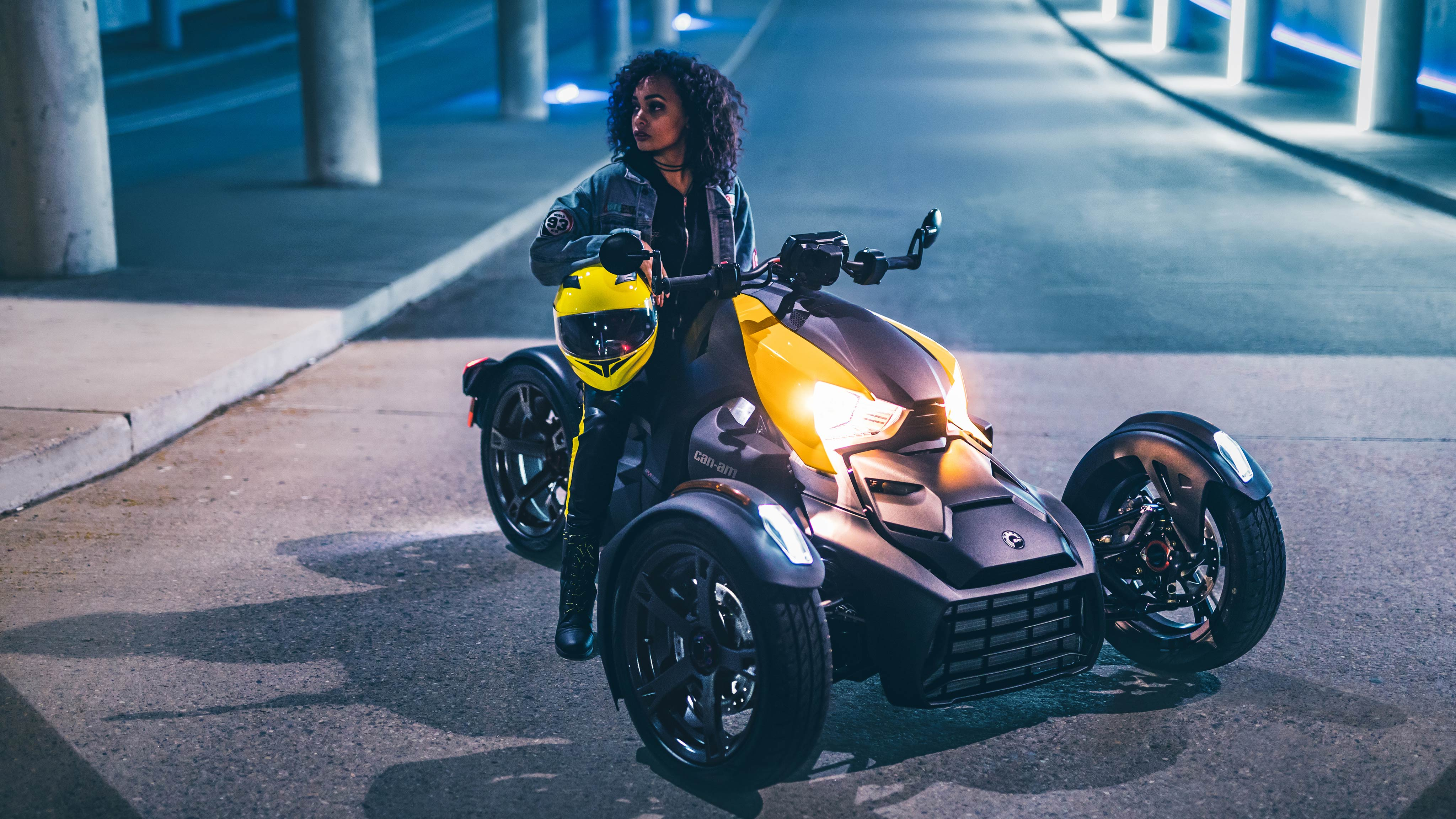 Woman sitting her Can-Am Ryker at night