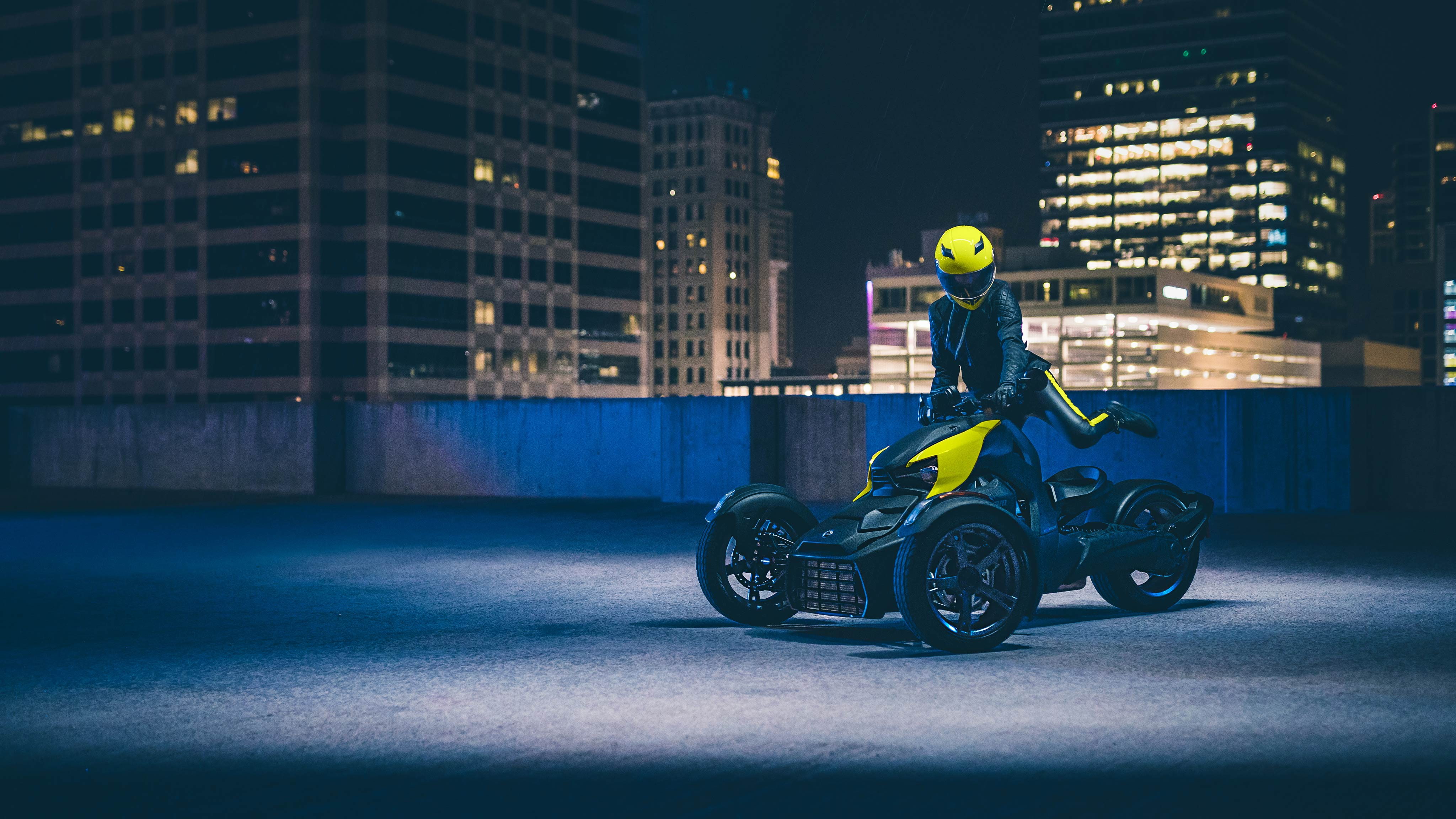 Woman riding her Can-Am Ryker at night