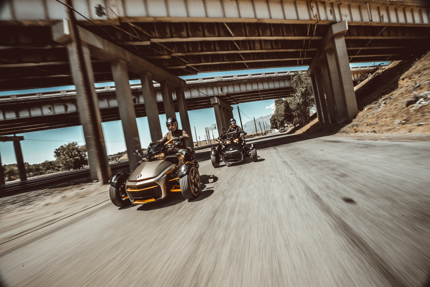 Three friends driving their Spyder F3 on a motorway