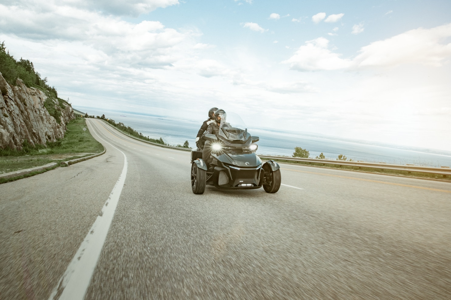 A couple driving a Can-Am Spyder RT on a scenic road