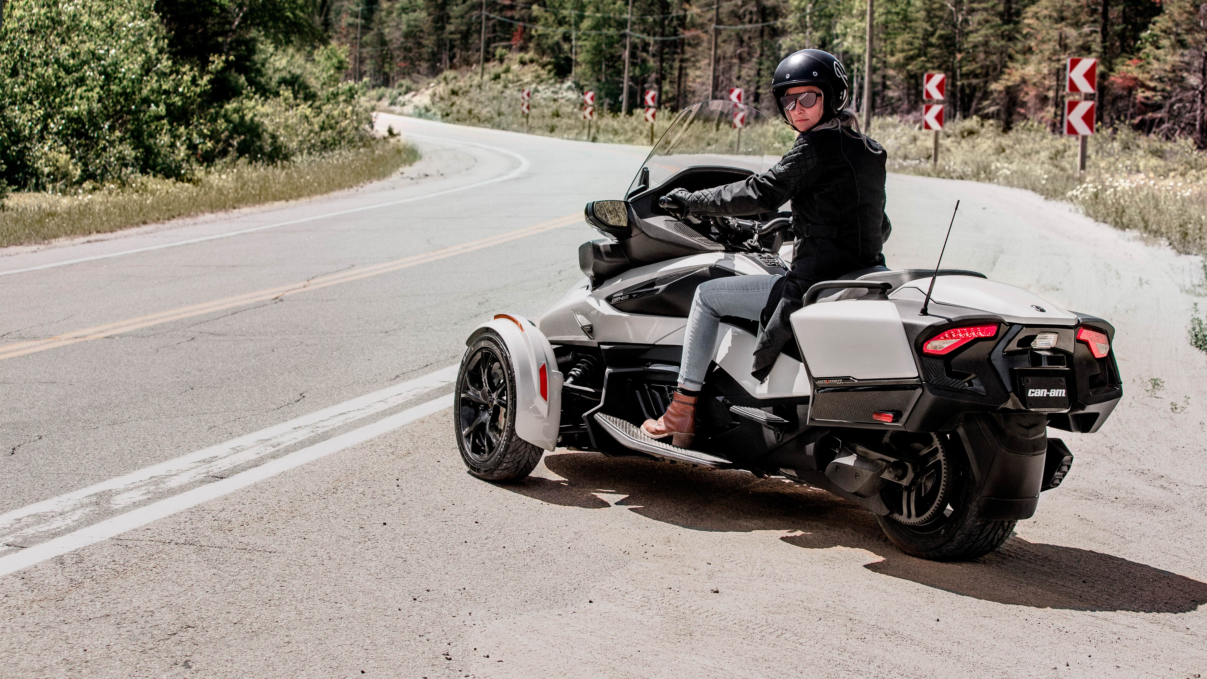 Woman riding Can-Am Spyder RT pearl white vehicle