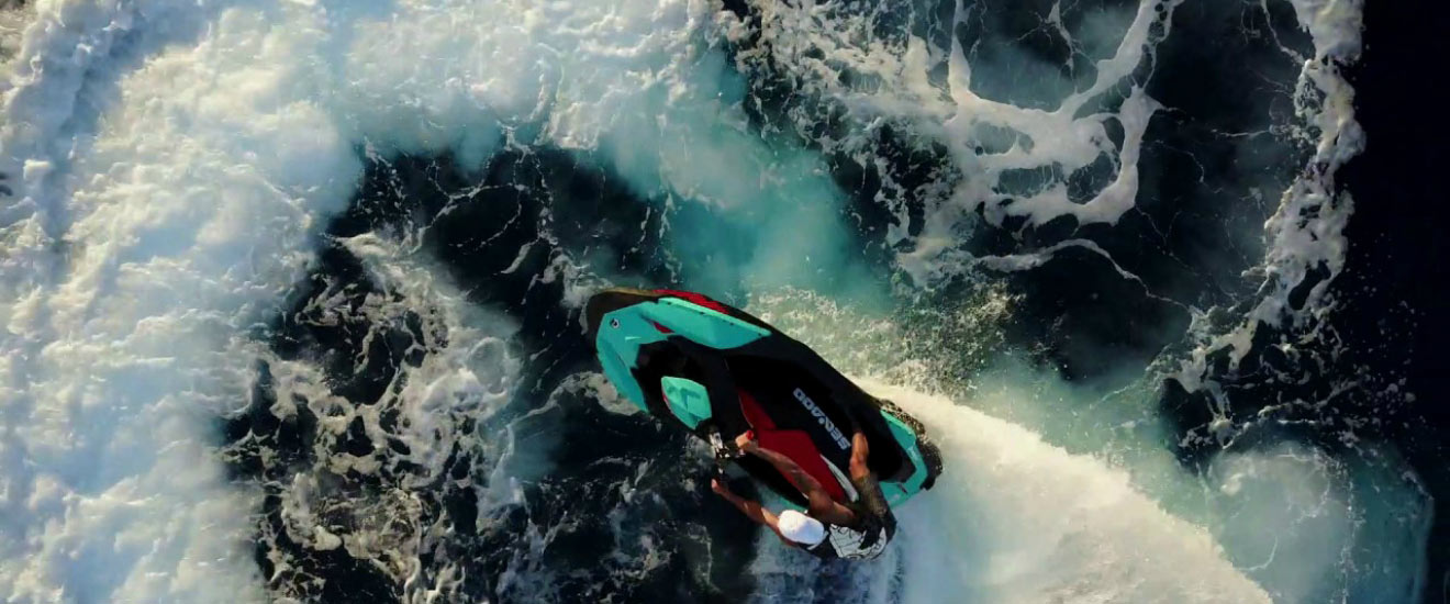 Bird view of a man riding his Sea-doo personal watercraft in the waves