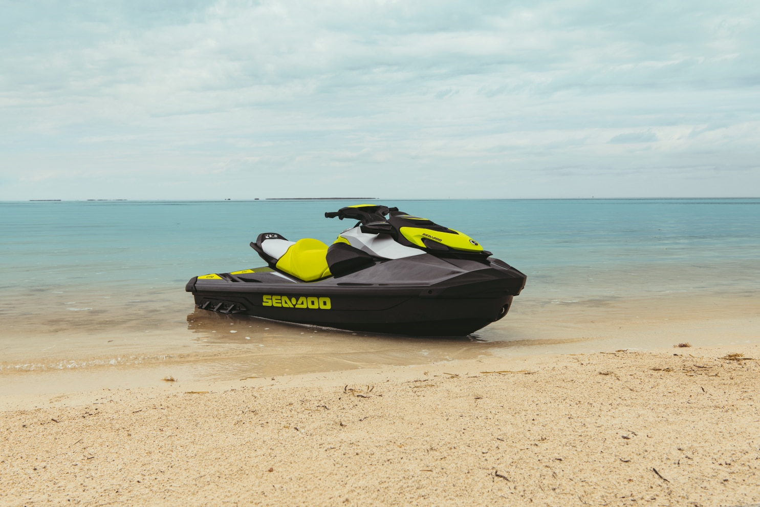 A Sea-Doo GTR parked on the sand of a beach