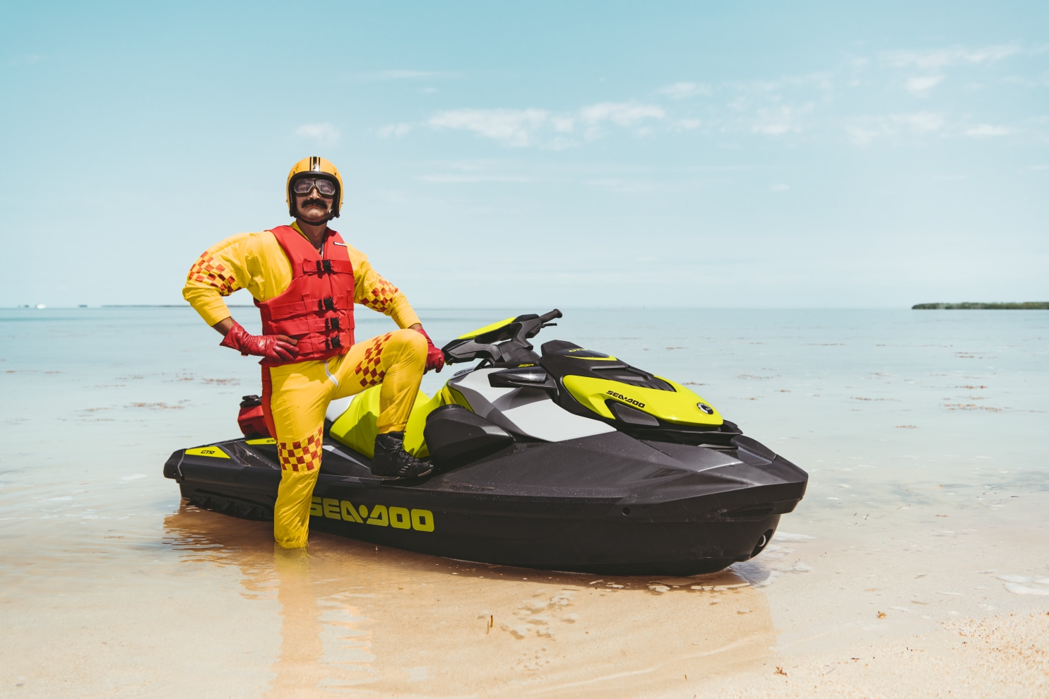 Mustached man standing proudly next to his Sea-Doo GTR