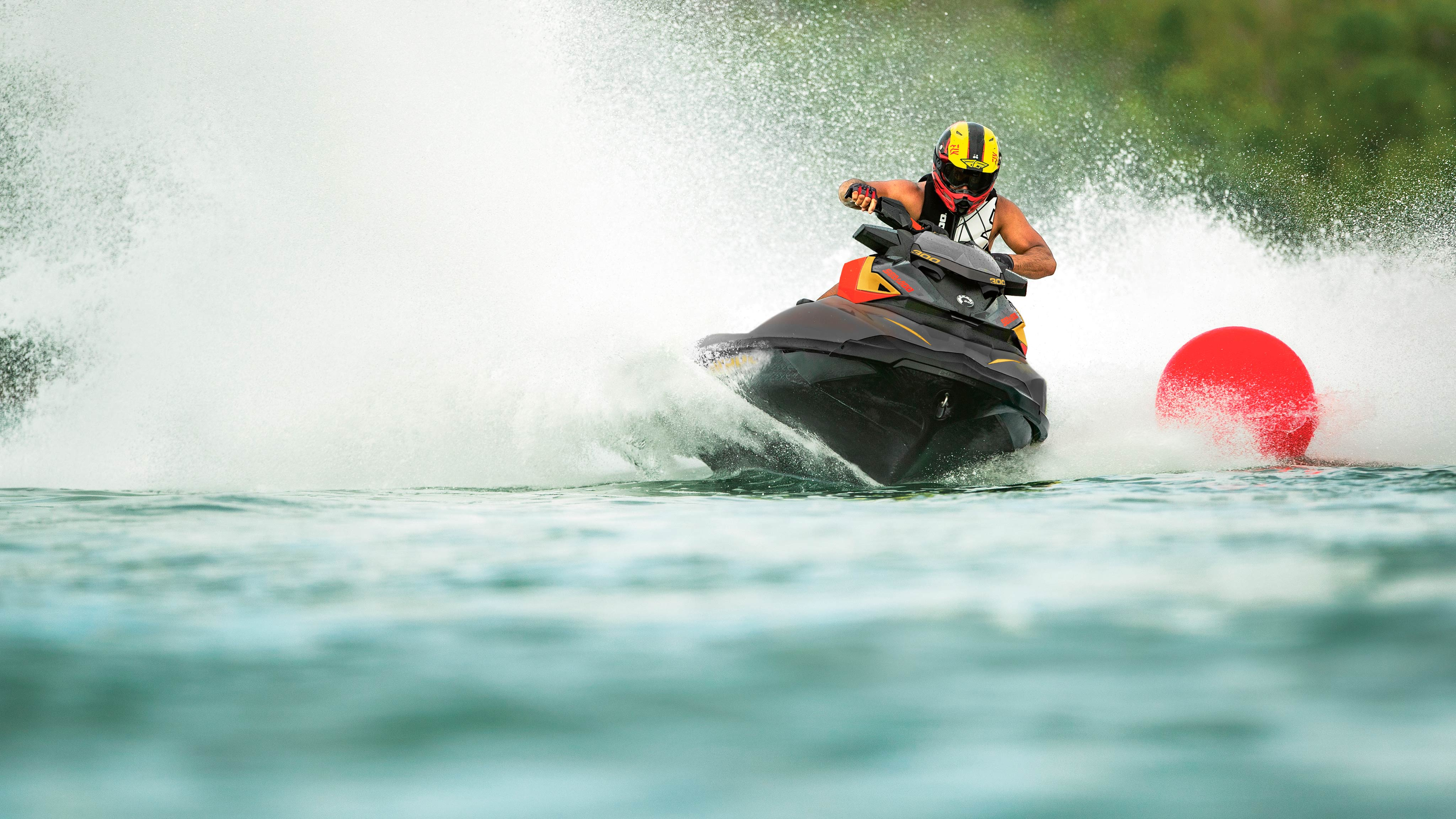 Man wearing helmet riding his Sea-Doo RXP-X