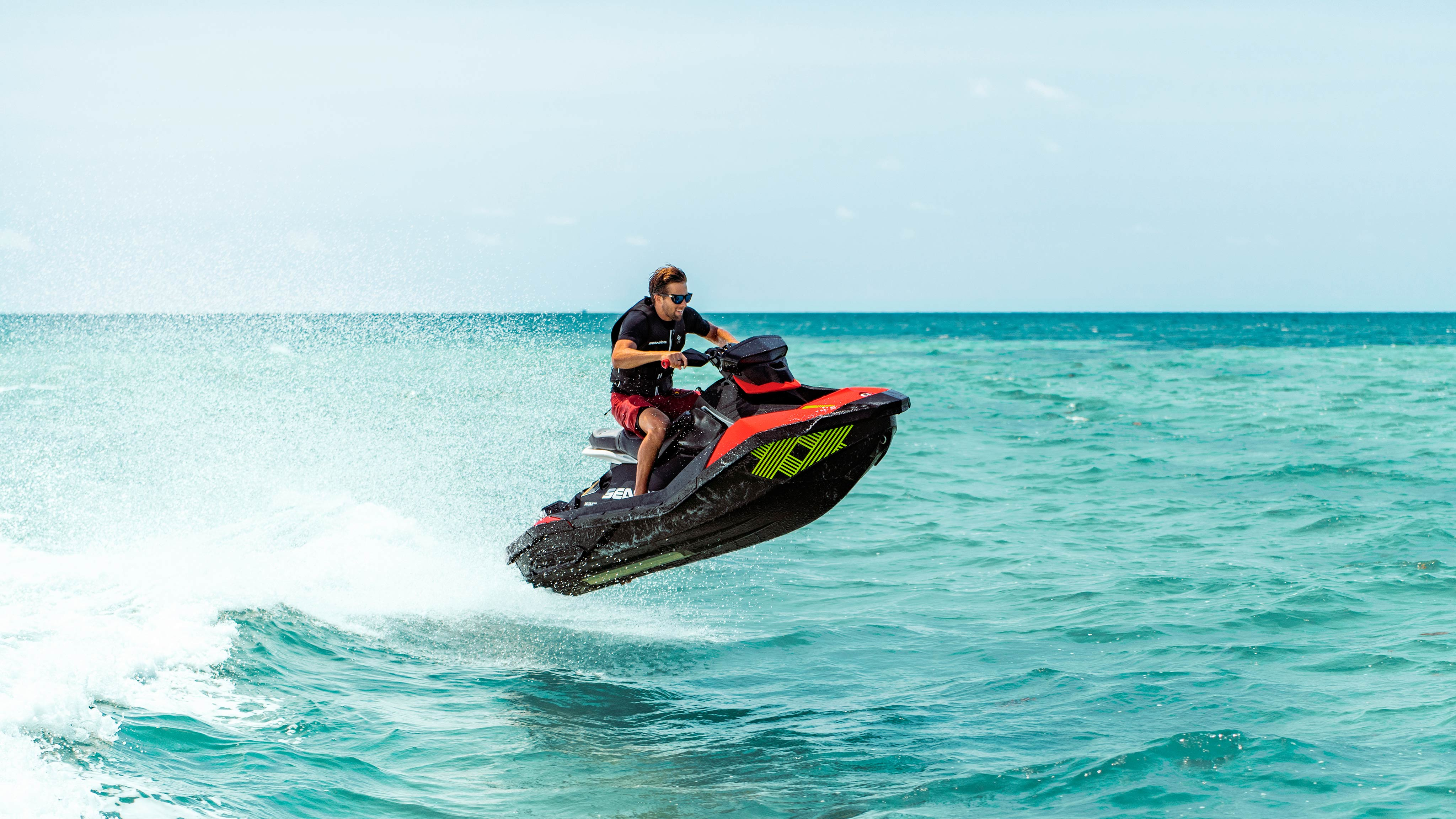 Man jumping a wave with his Sea-Doo Spark Trixx