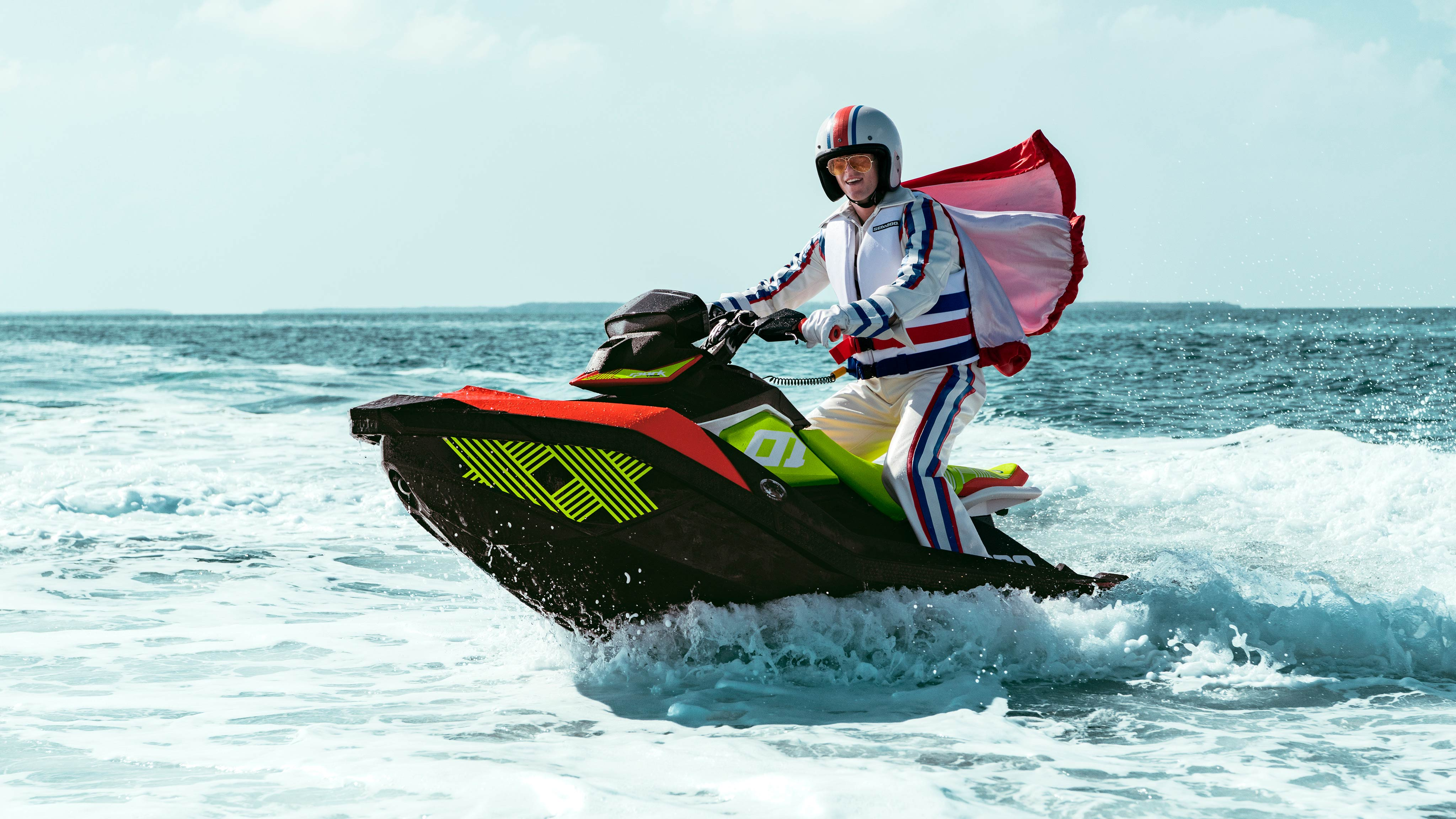 Costumed man standing up on his Sea-Doo Spark Trixx