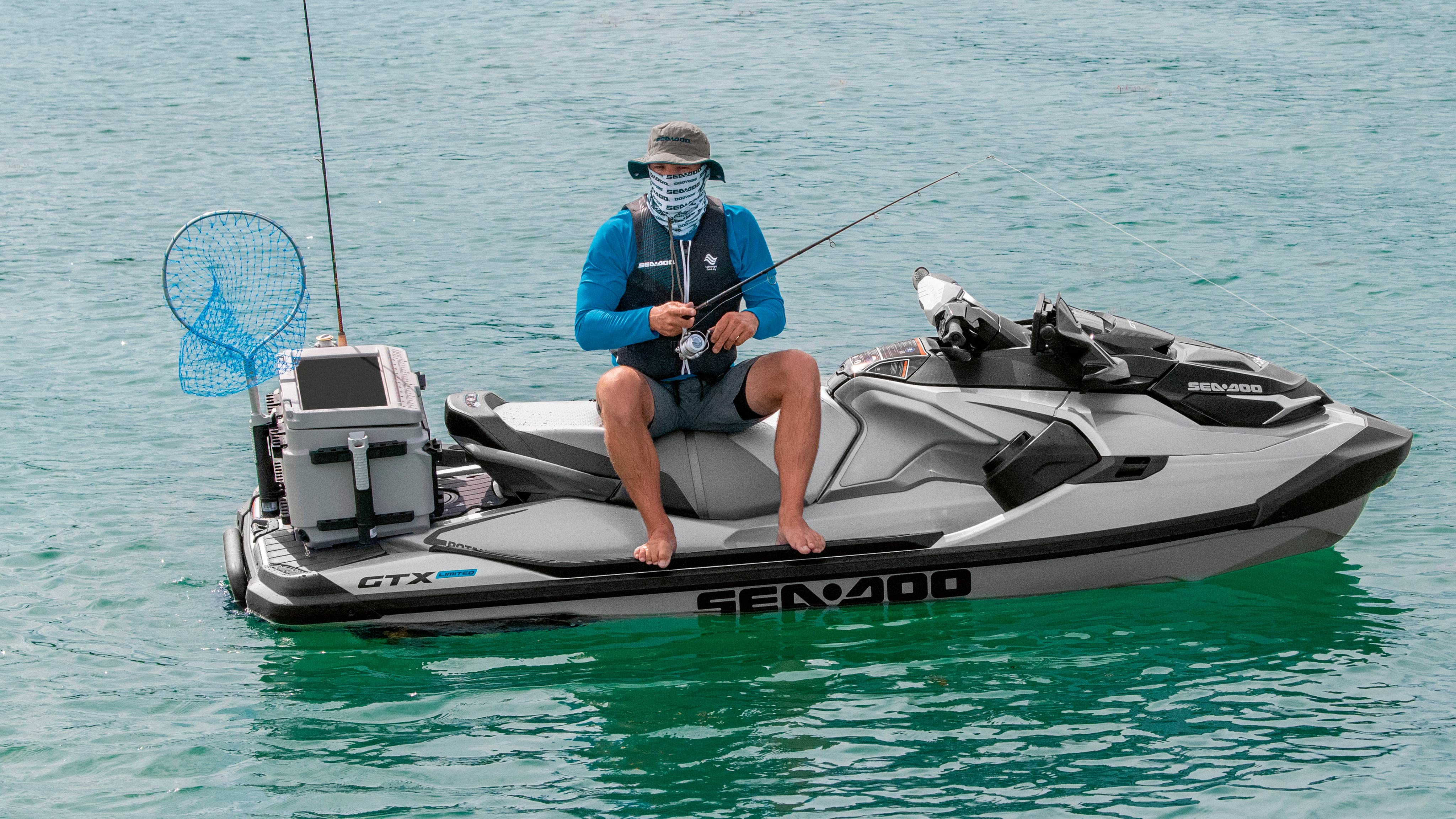 Man fishing while sitting on his Sea-Doo GTX Limited Edition