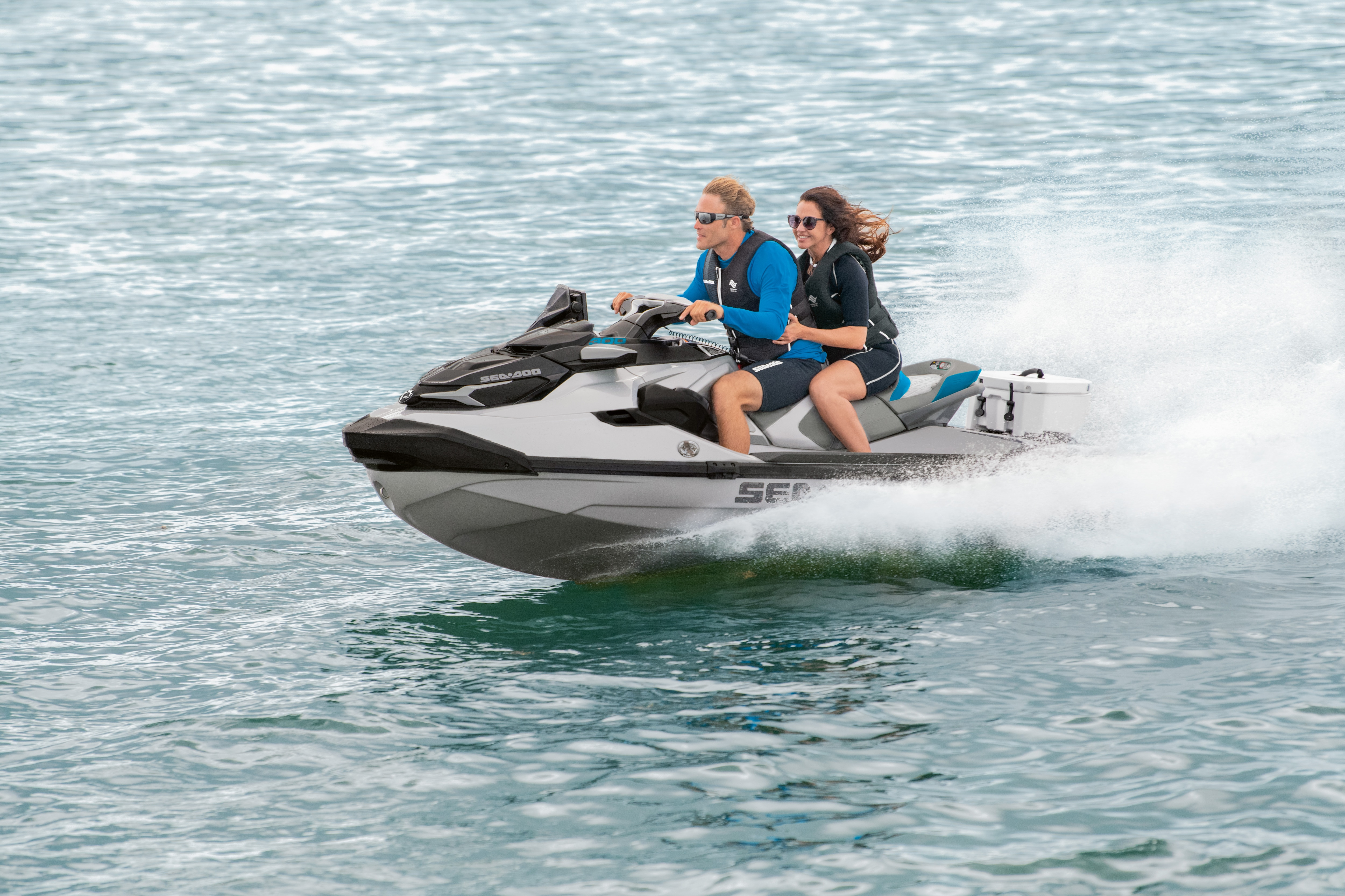 Wide shot of man and woman riding a Sea-Doo GTX LTD
