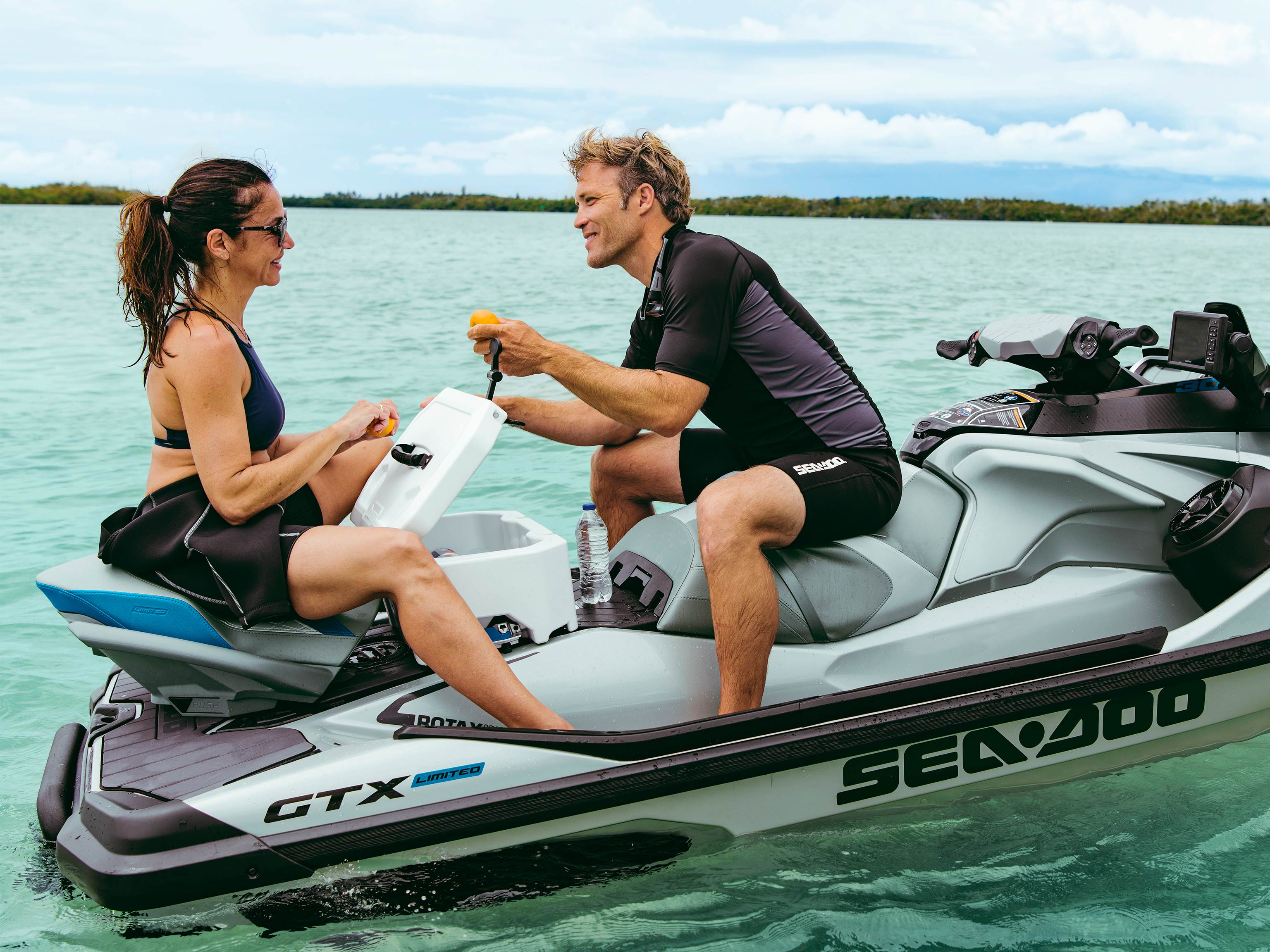 Man and Woman discussing on the back of a Sea-Doo GTX LTD