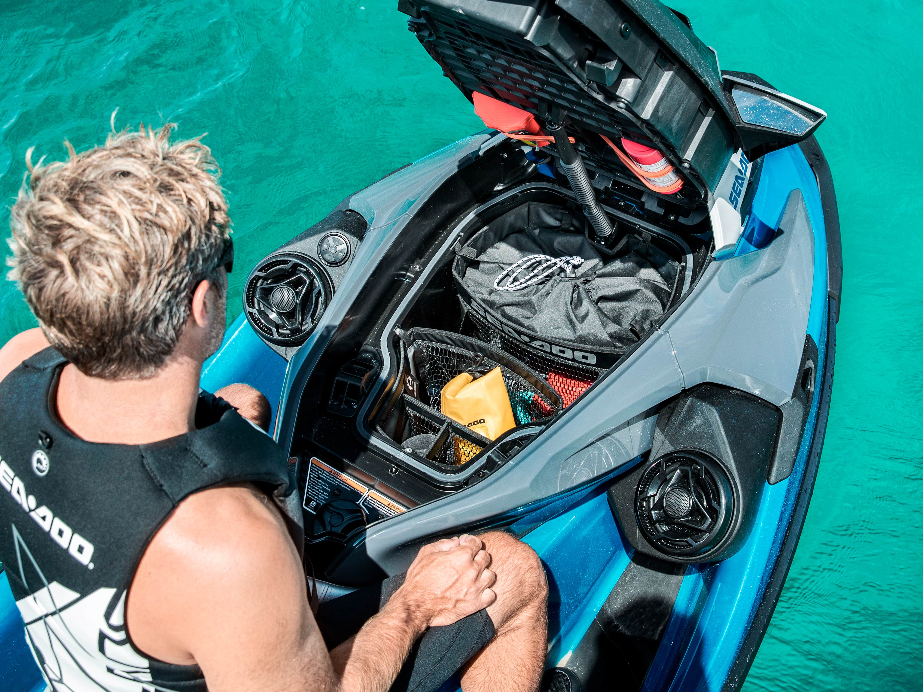 Man using the new storage on his Sea-Doo GTX