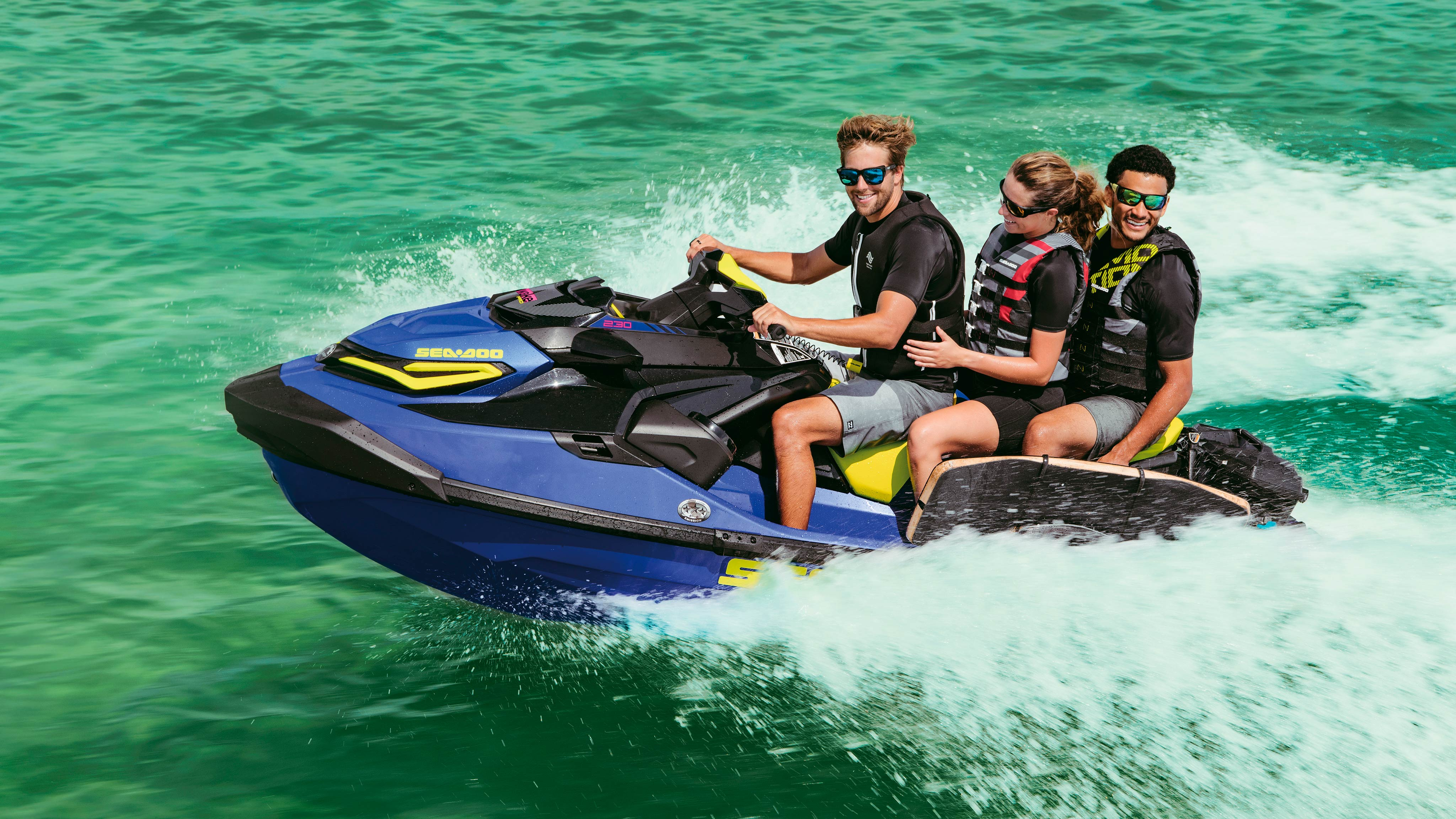 Group of three riding a Sea-Doo Wake Pro.