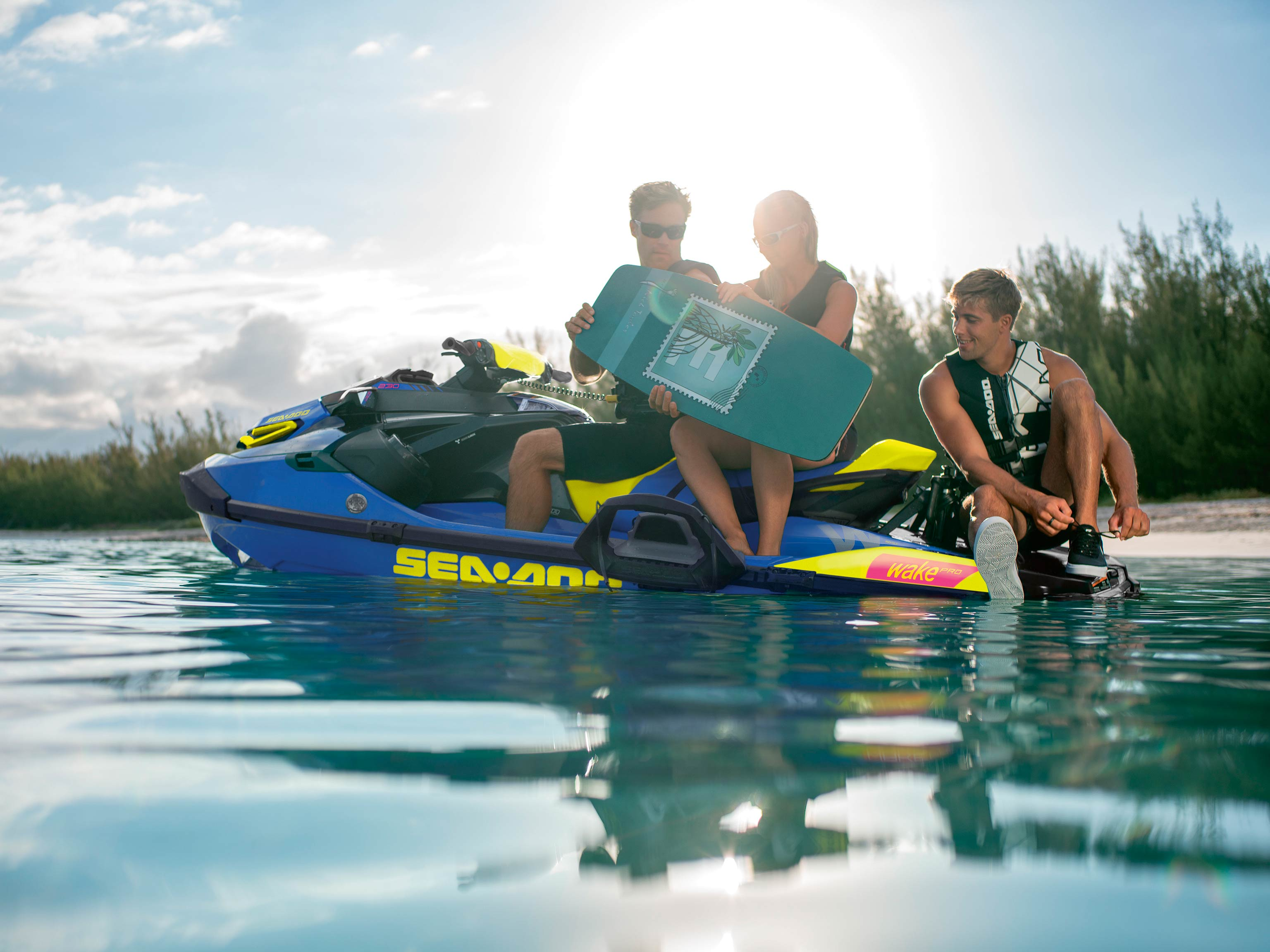 Group of three relaxing on a Sea-Doo Wake Pro