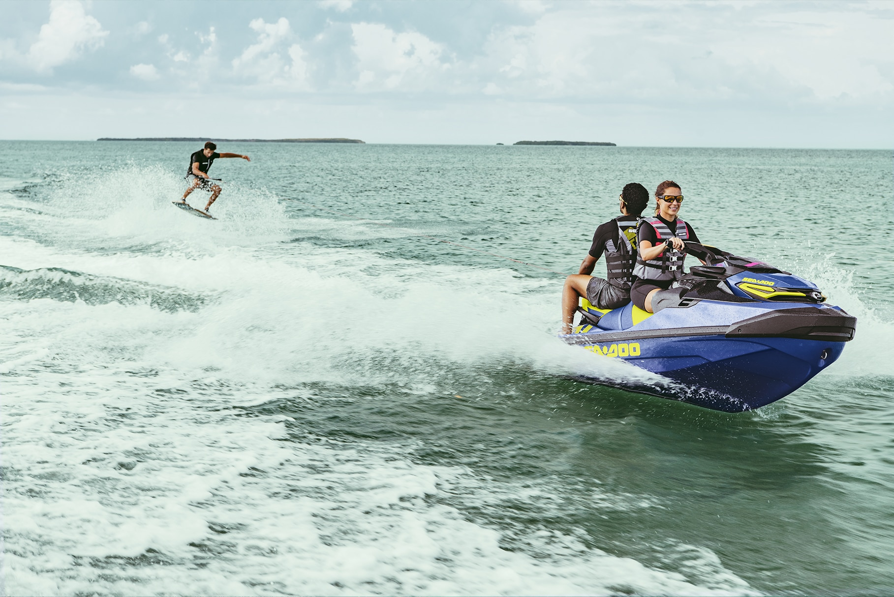 Couple towing a wakeboard with a Sea-Doo Wake