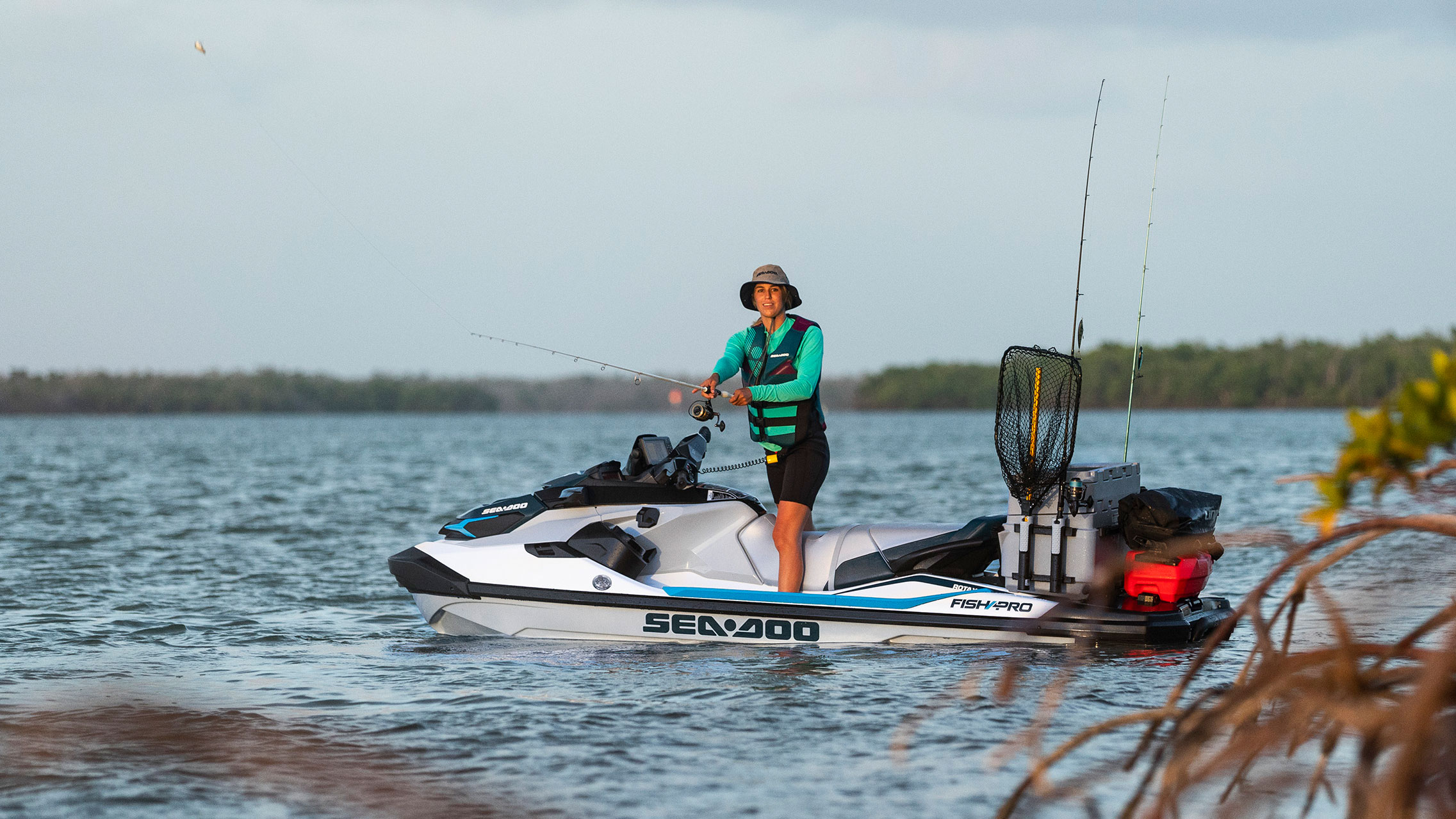Women fishing on her Sea-Doo FISH PRO