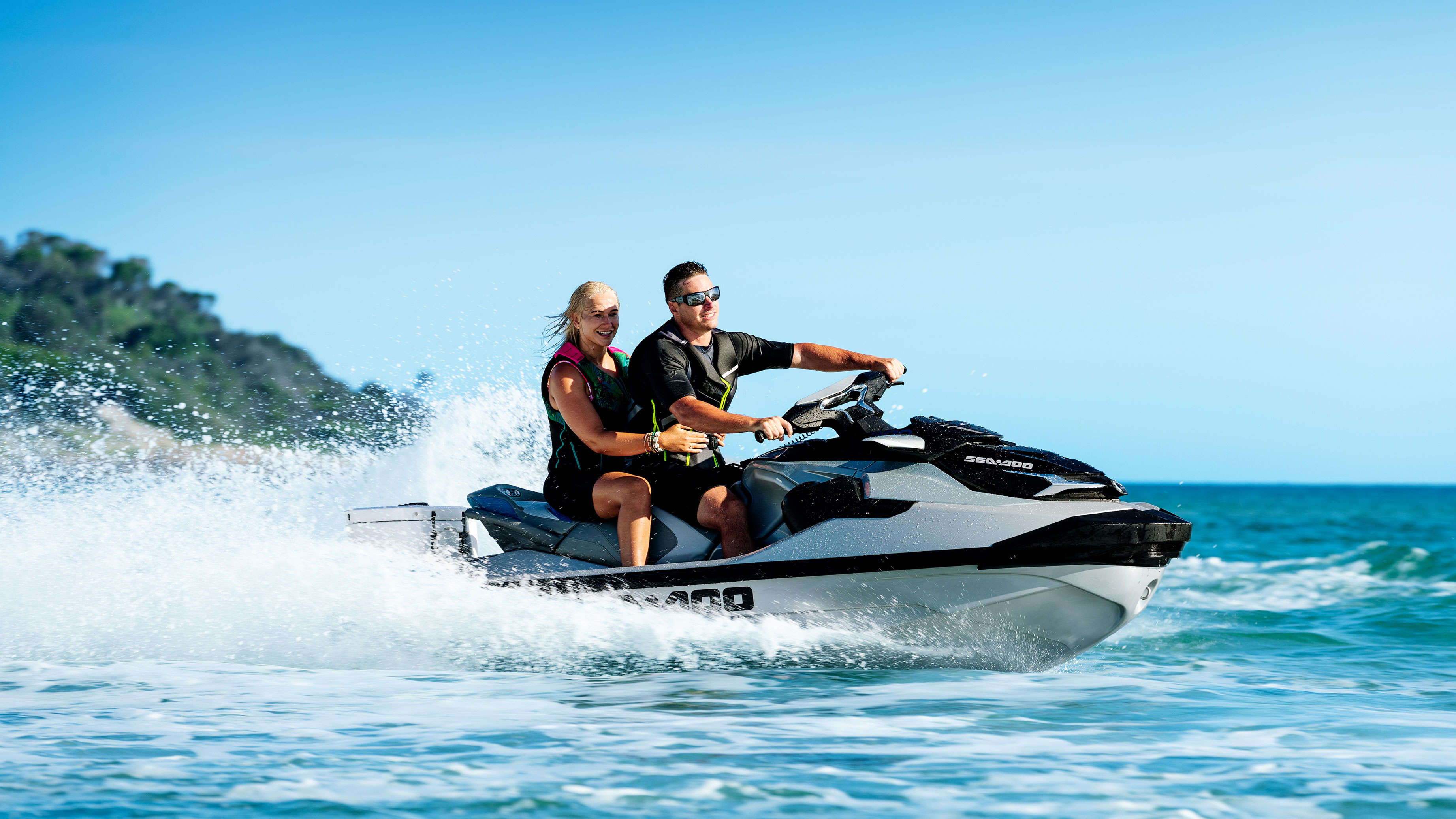 Couple riding a Sea-Doo GTX Limited