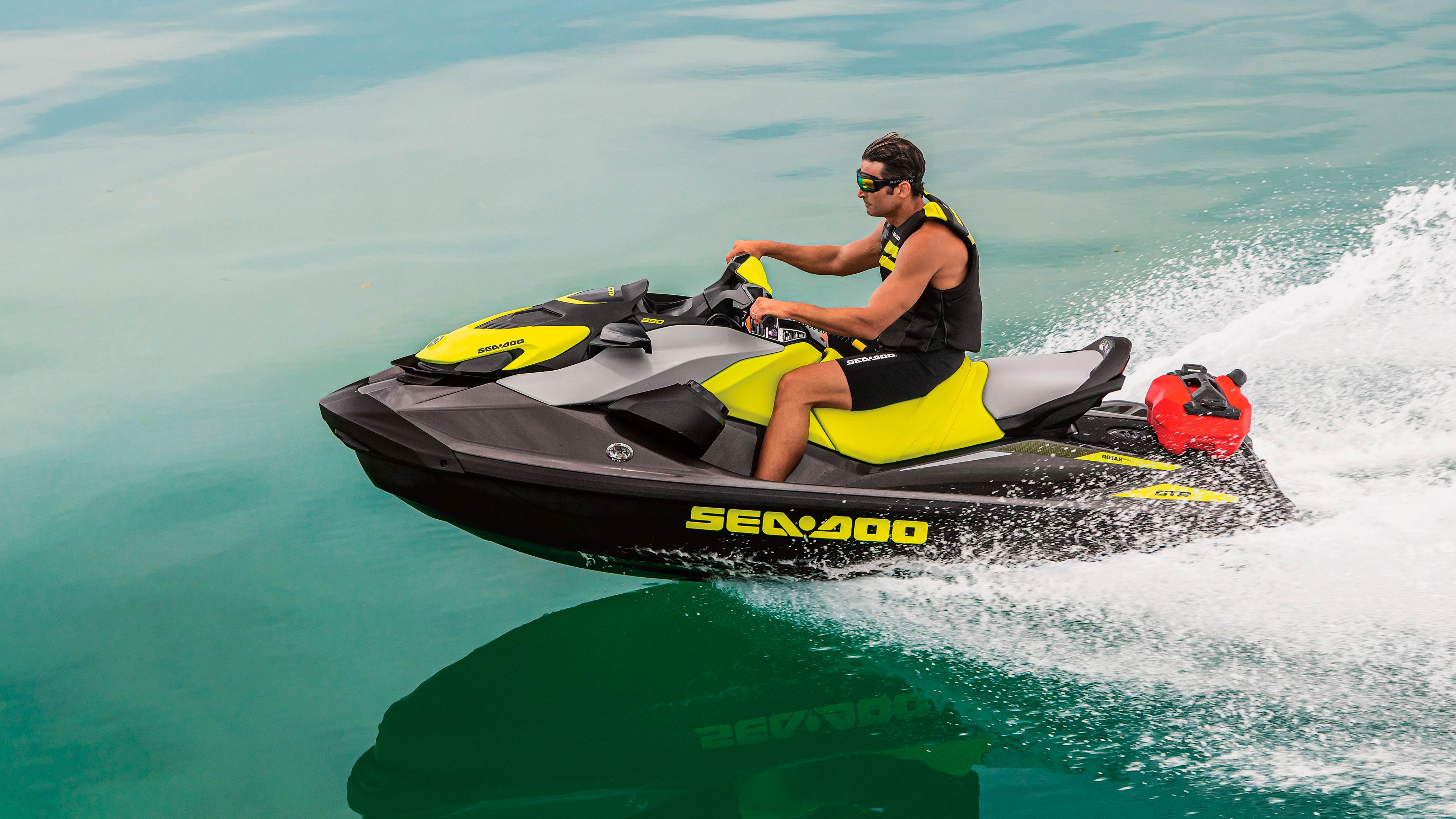 Mustached man riding his Sea-Doo GTR