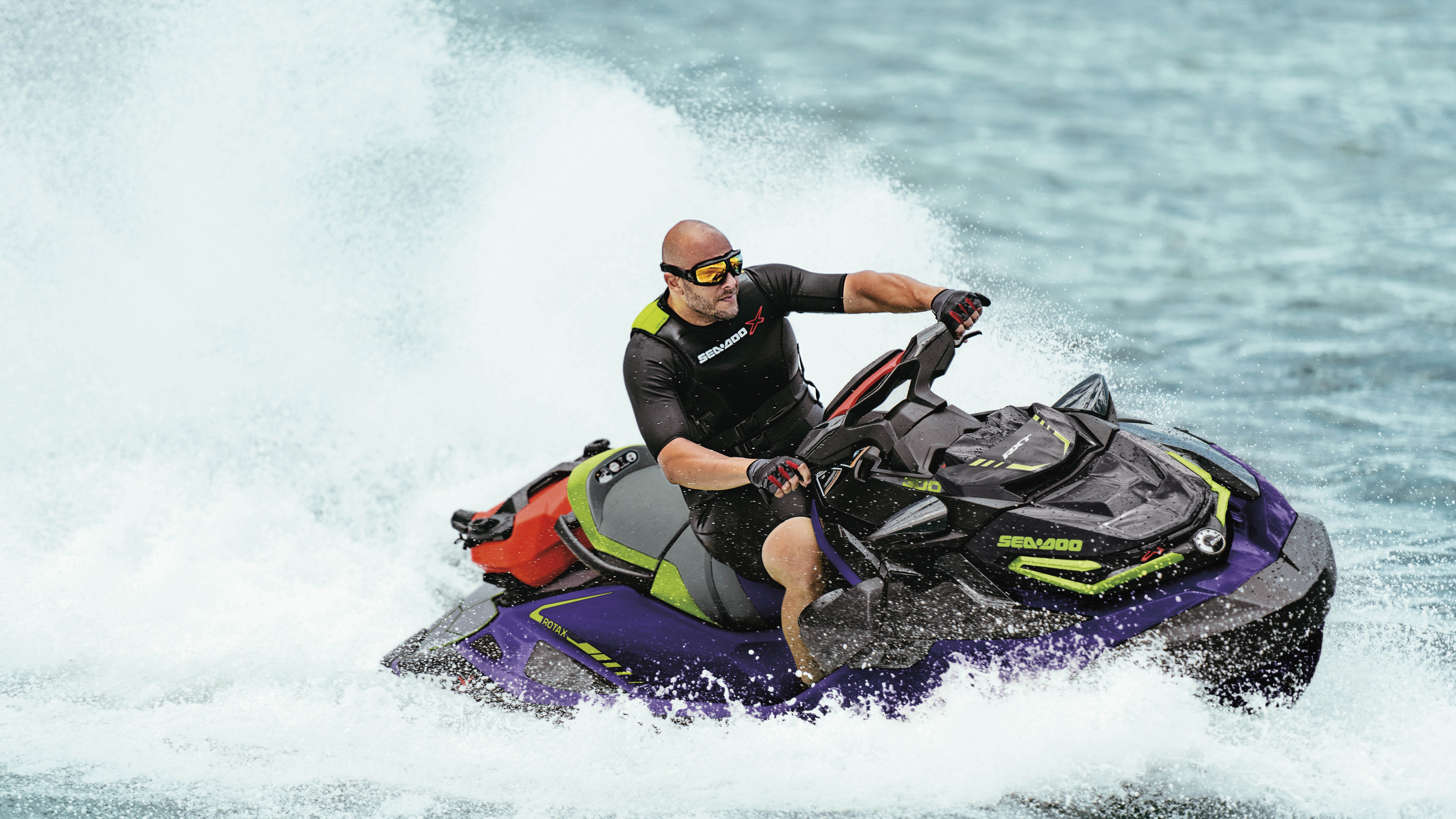 Man carving with a Sea-Doo RXT-X and the large swim platform