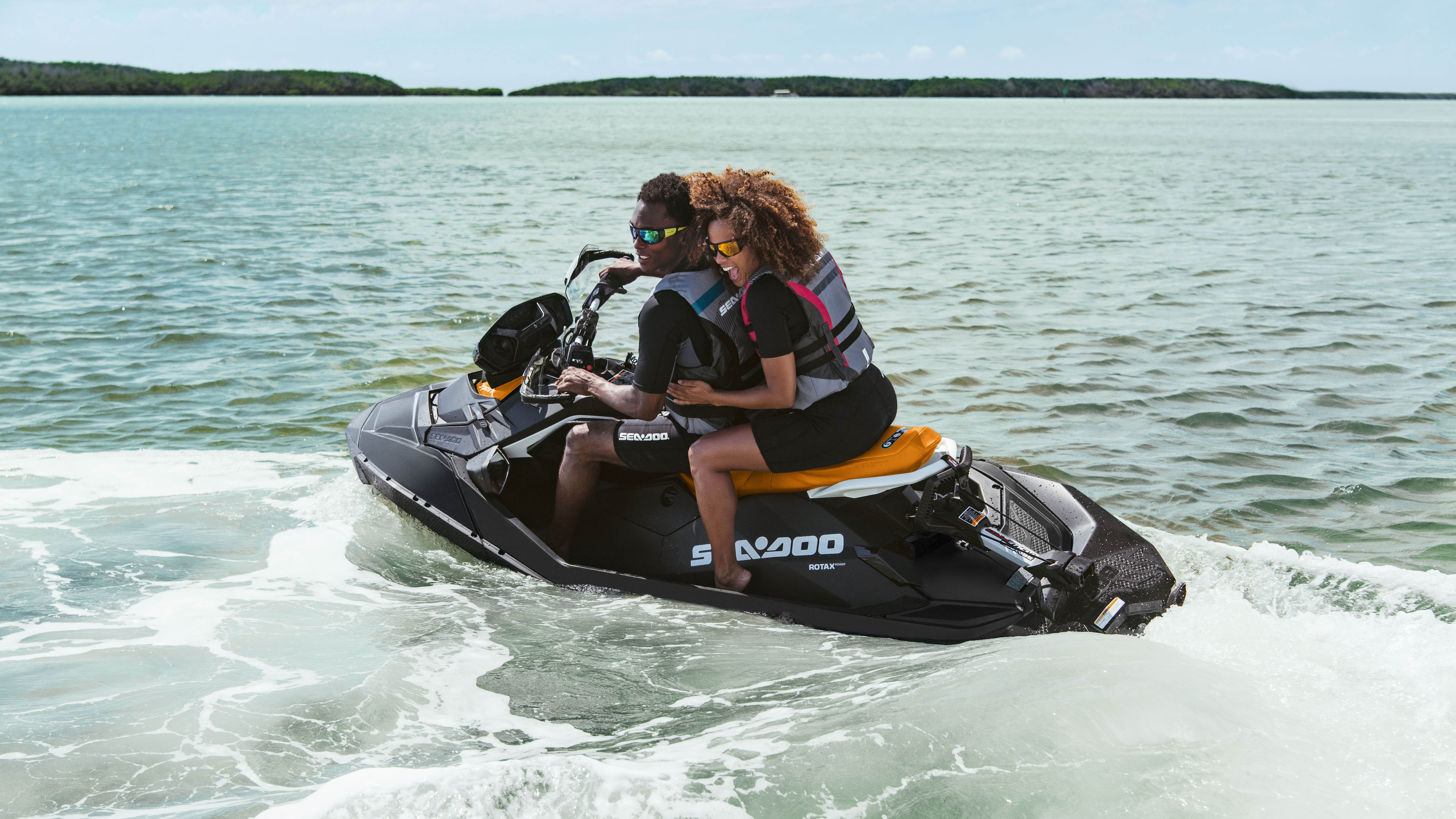 A couple riding their Sea-Doo Spark in the water