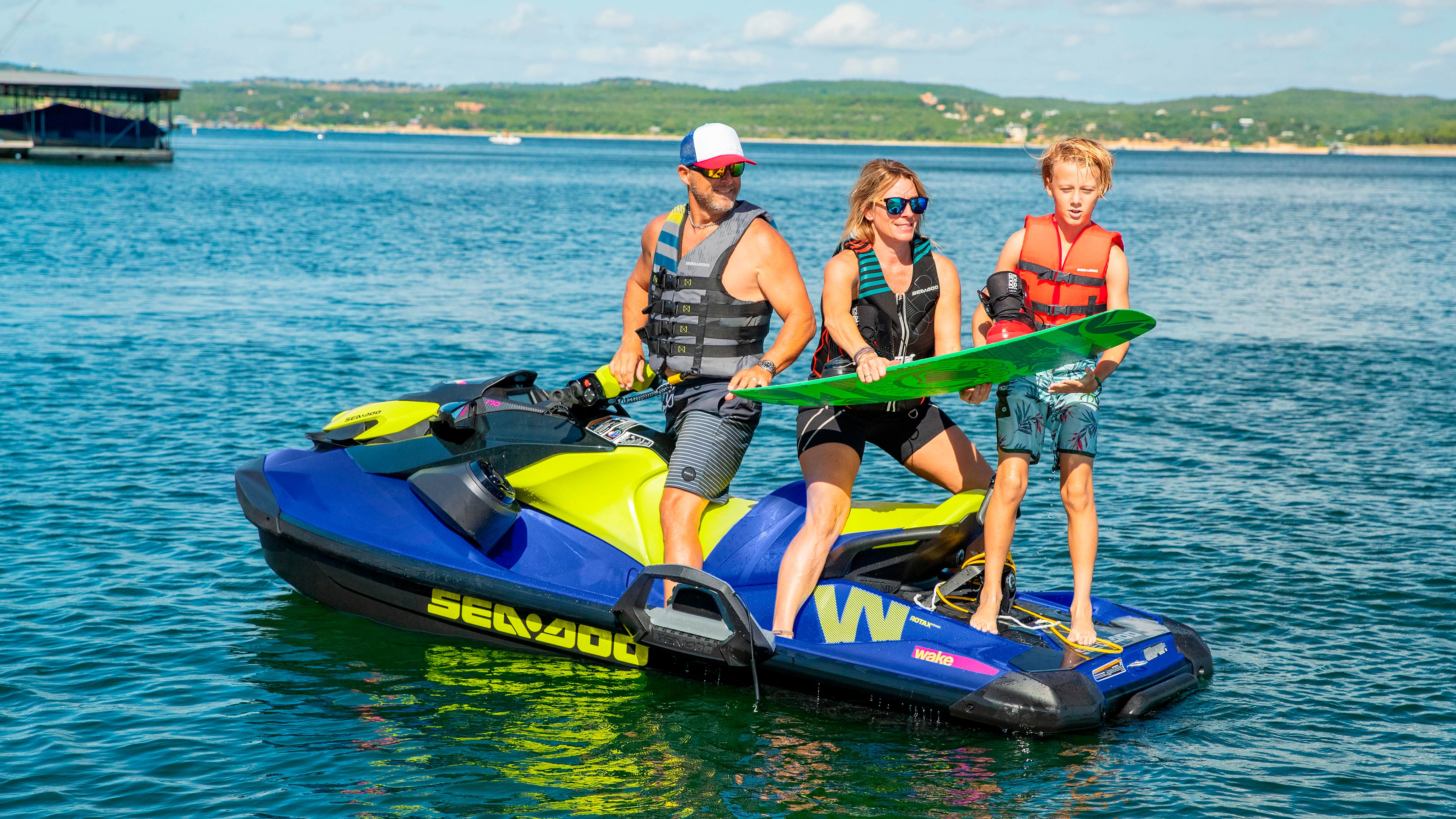 Family preparing a wakeboard ride on Sea-Doo Wake