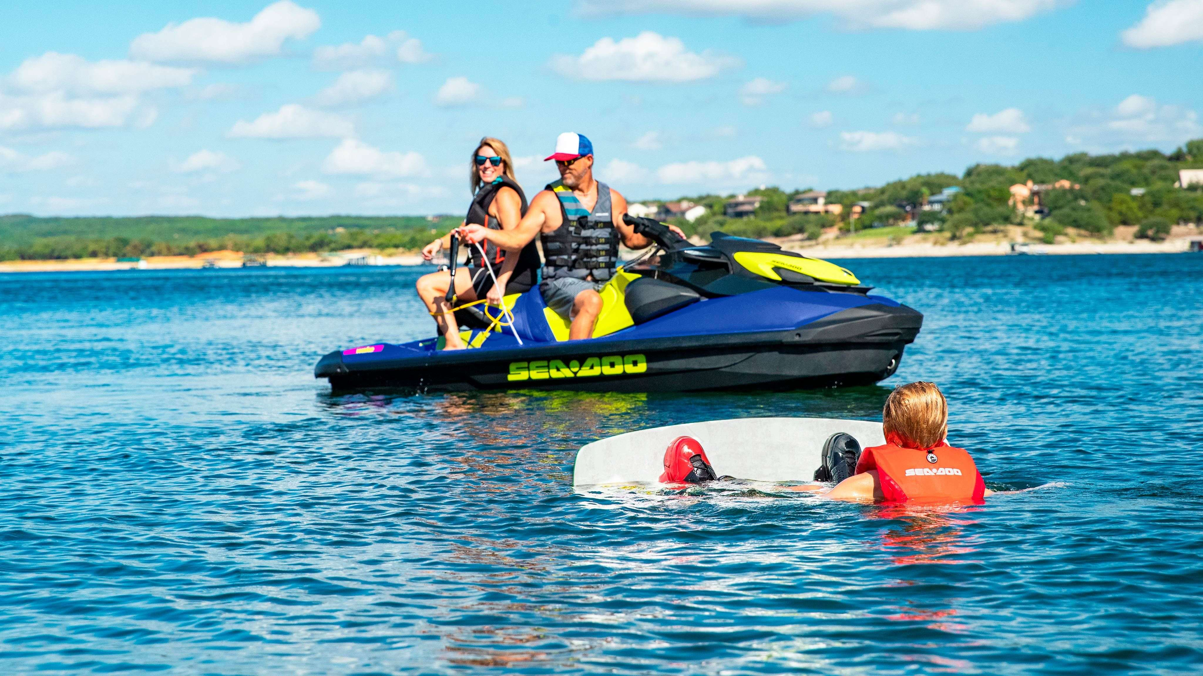 Family enjoying a wakeboard ride on Sea-Doo Wake