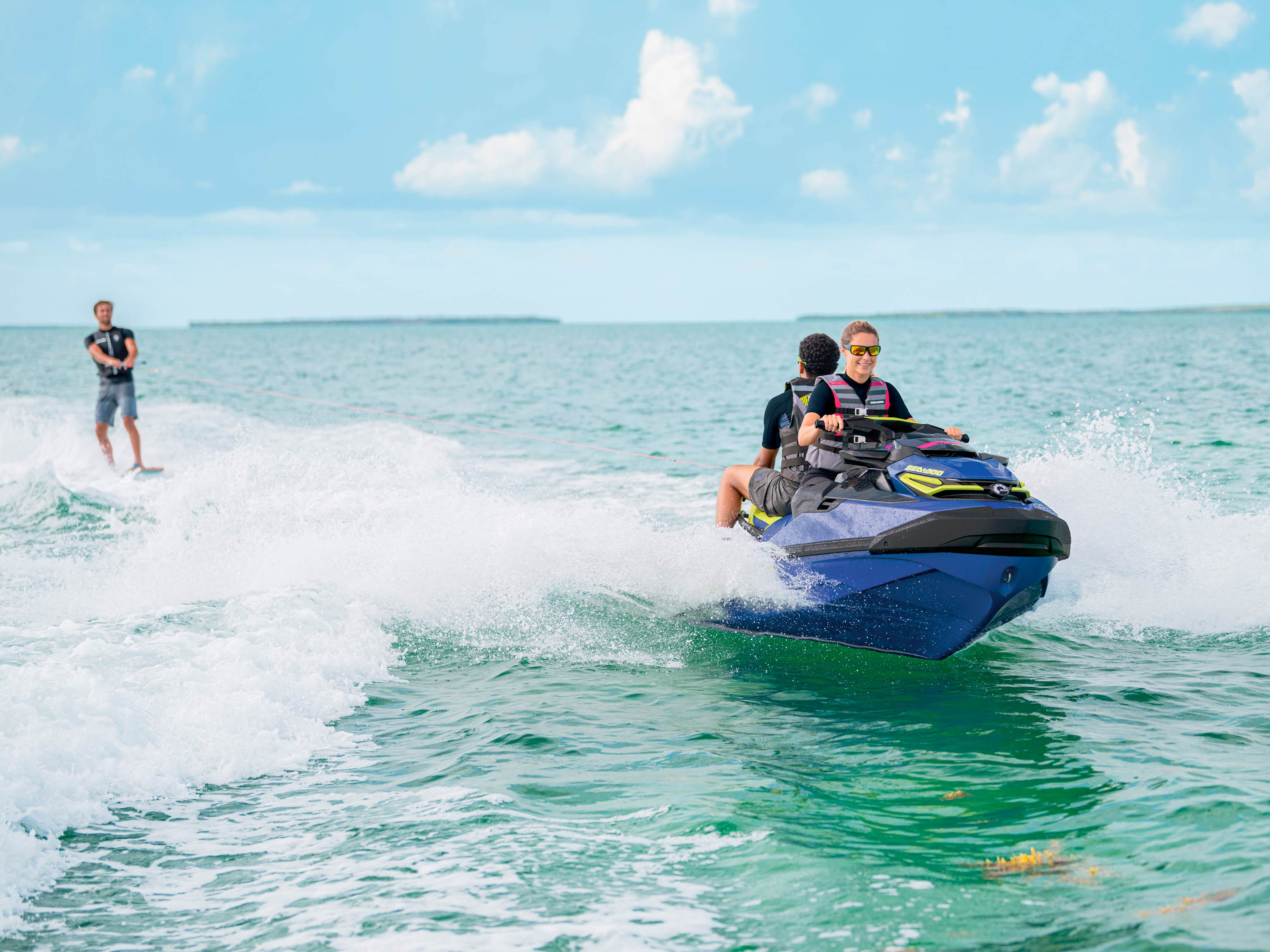 Group of three riding a Sea-Doo Wake Pro 230