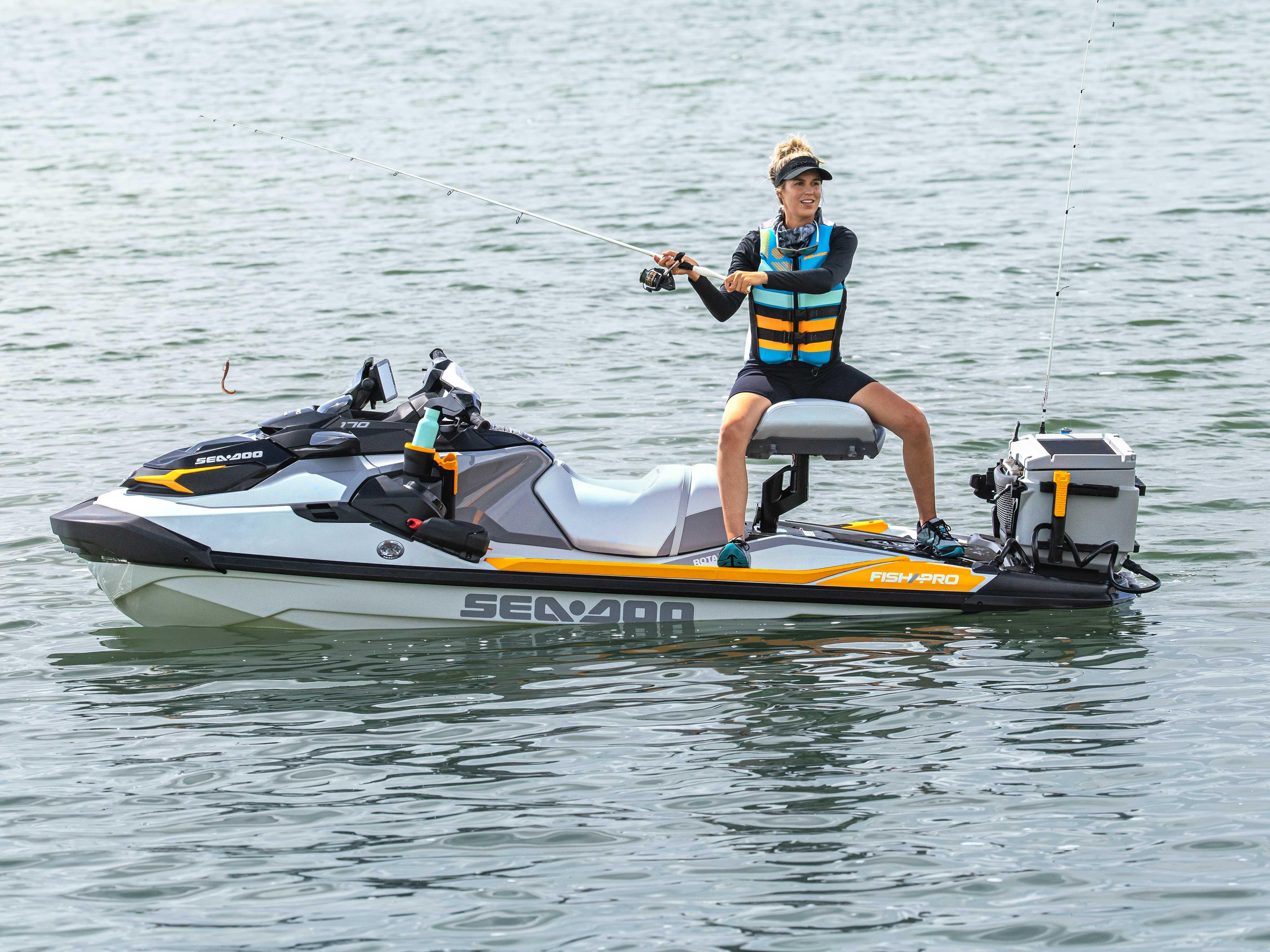 Woman fishing on her Sea-Doo FishPro Trophy with the new modular swivel seat
