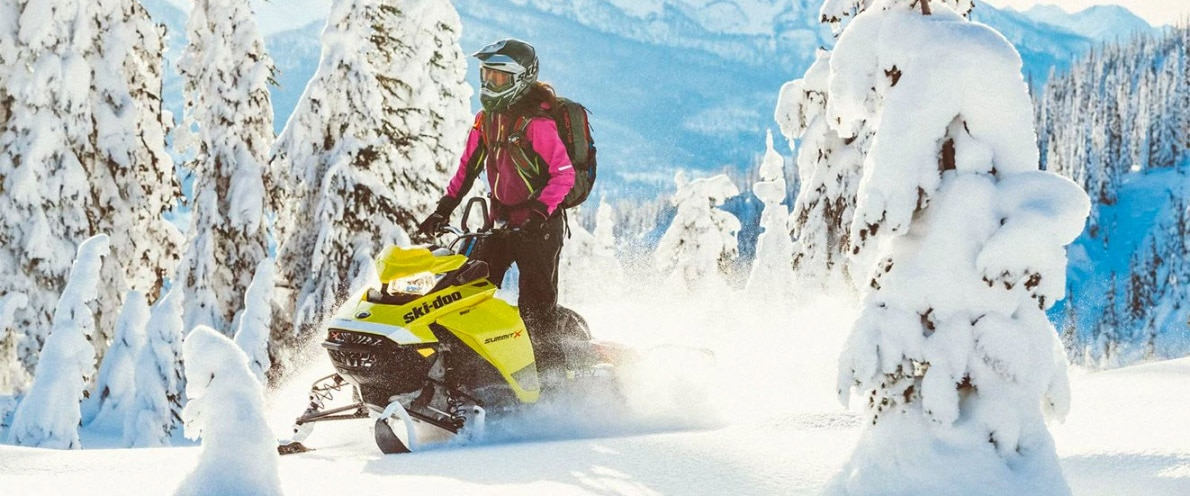 Woman standing up while driving her Ski-Doo Summit