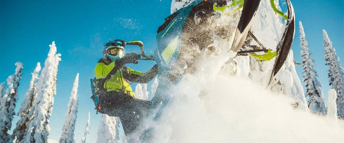 Close-up of a Man jumping through the air on his Ski-Doo Summit