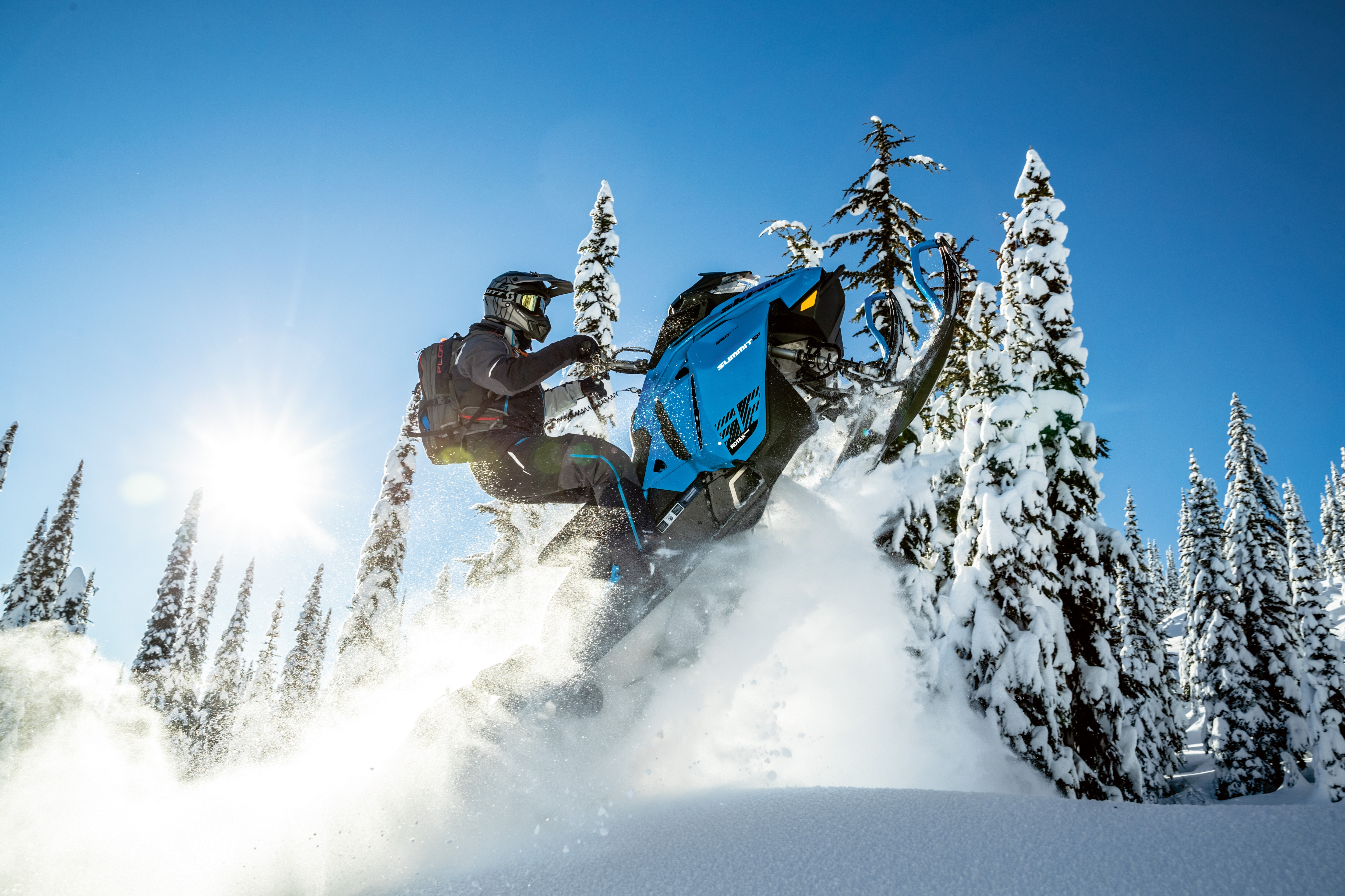Man jumping through the air with his Ski-Doo Summit